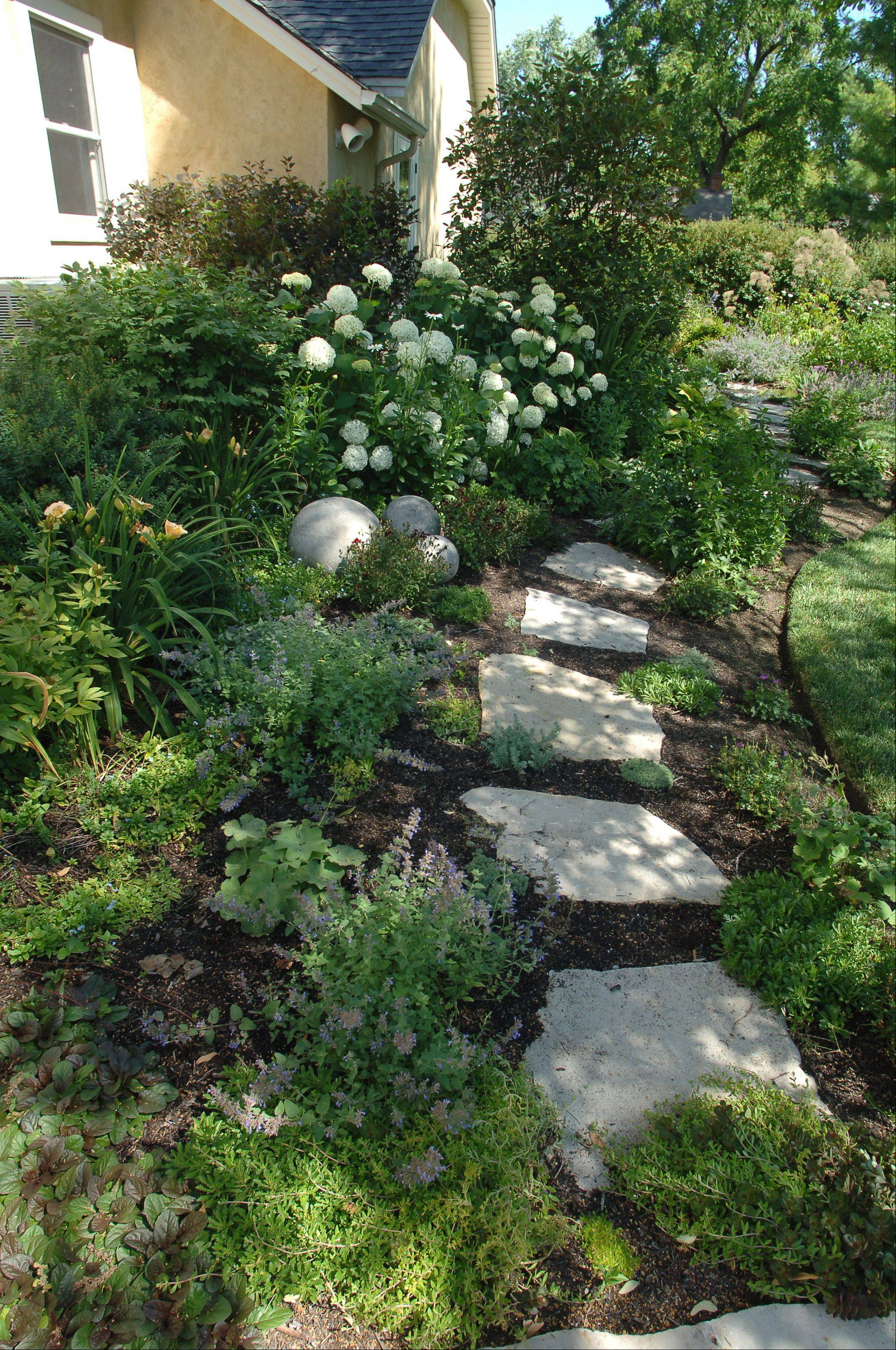 Susan Brunstrum loves the flagstone walkways through her gardens.