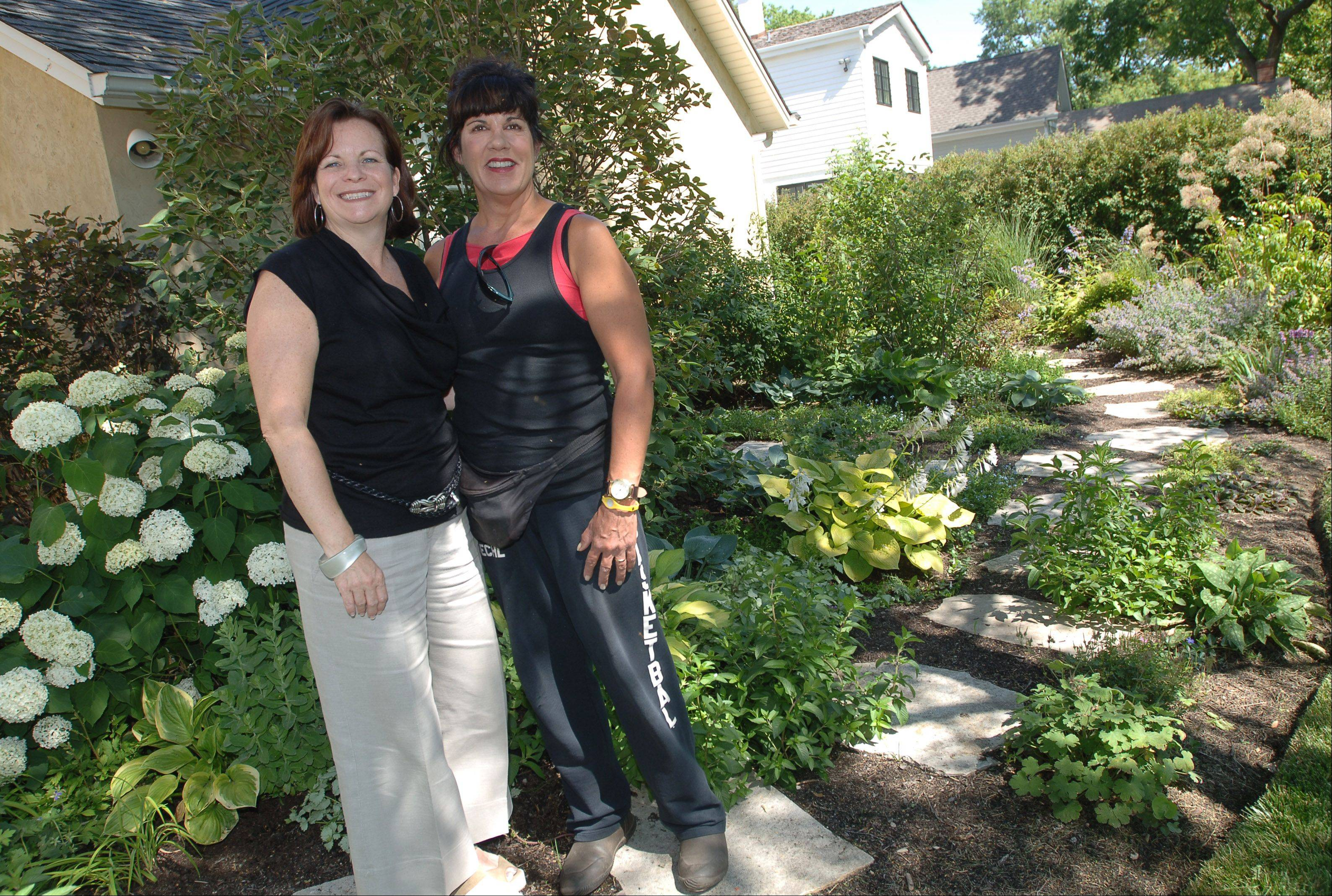 Suzanne Deichl of Suzennials in Libertyville, right, is one of the team members who worked with Susan Brunstrum to design her gardens.