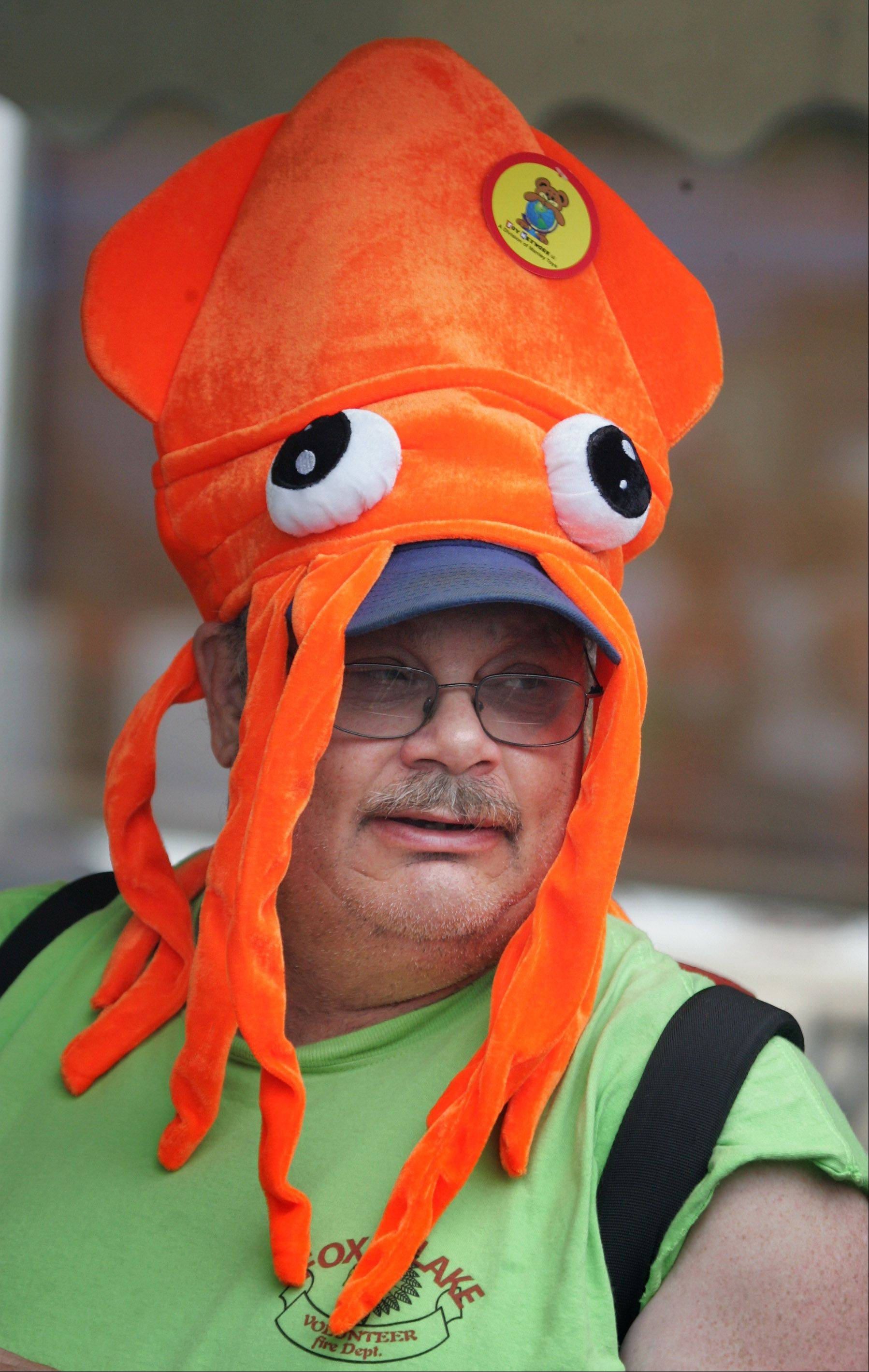 Fox Lake firefighter Bob Smith wears a squid hat during the water fights Sunday at the 54th annual Fox Lake Fireman's Festival.
