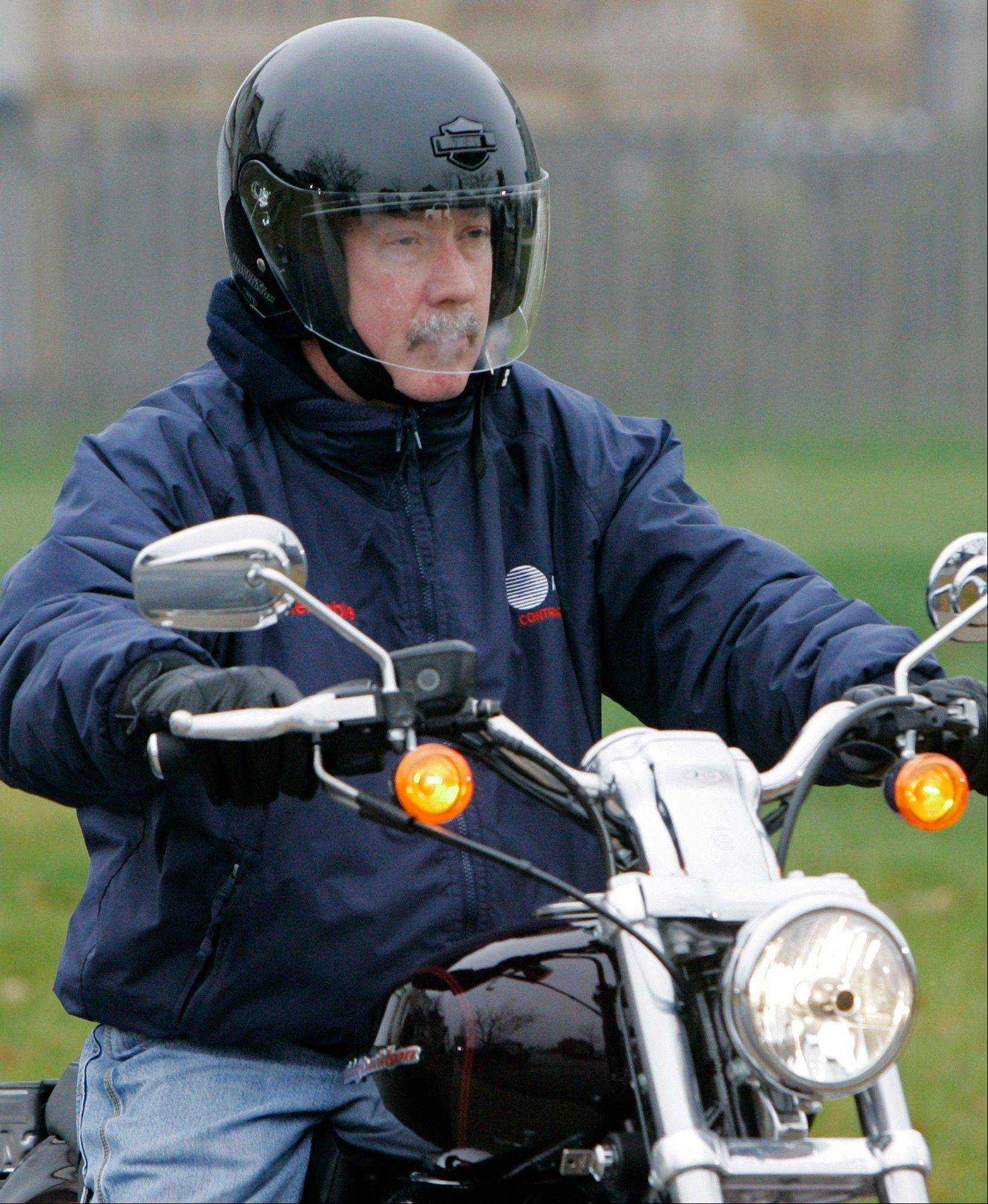 Former Bolingbrook police sergeant Drew Peterson leaves his Bolingbrook home on his motorcycle in 2007.