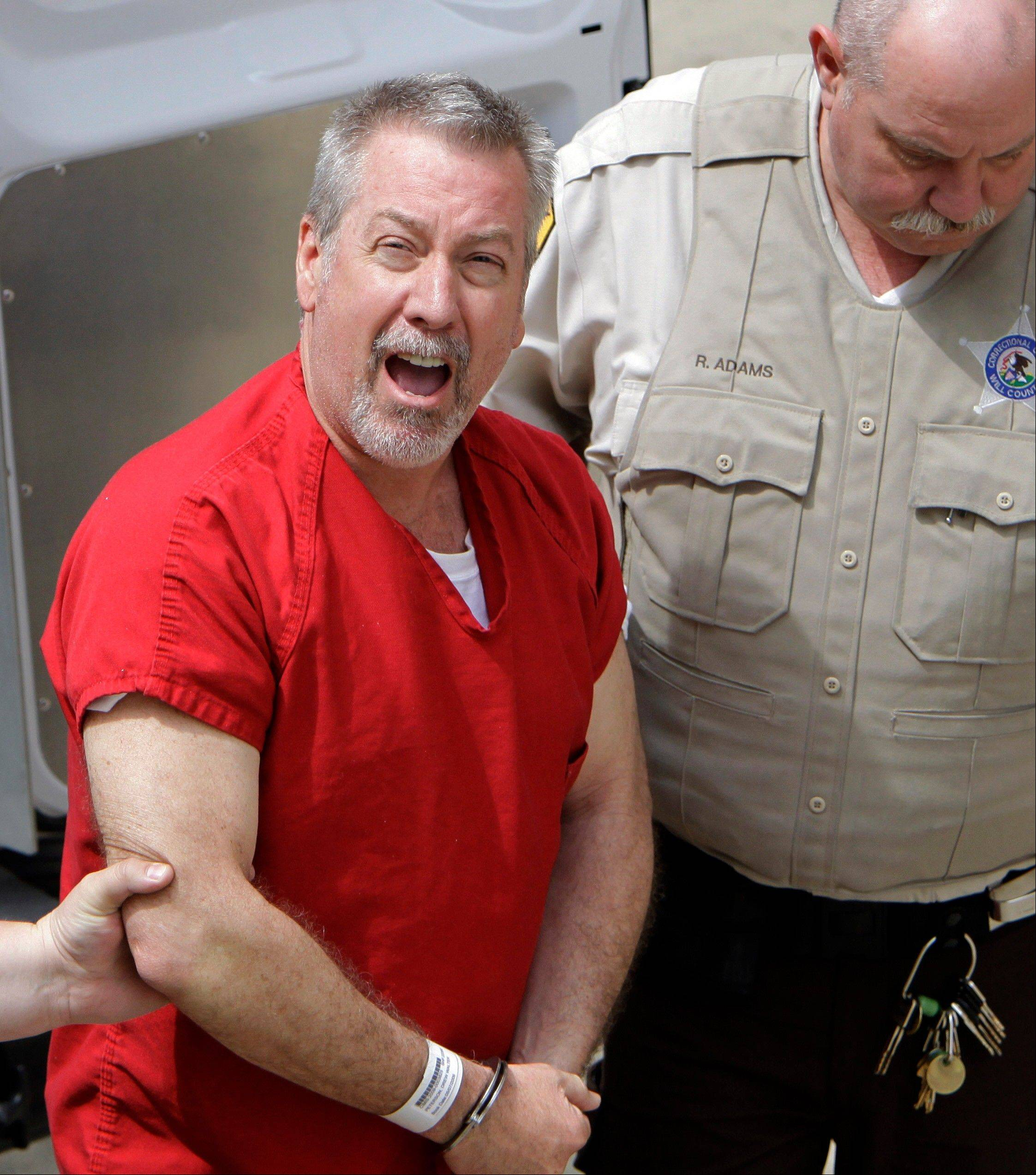 Drew Peterson yells to reporters as he arrives at the Will County courthouse in 2009 for his arraignment on charges of first-degree murder in the 2004 death of his former wife Kathleen Savio.