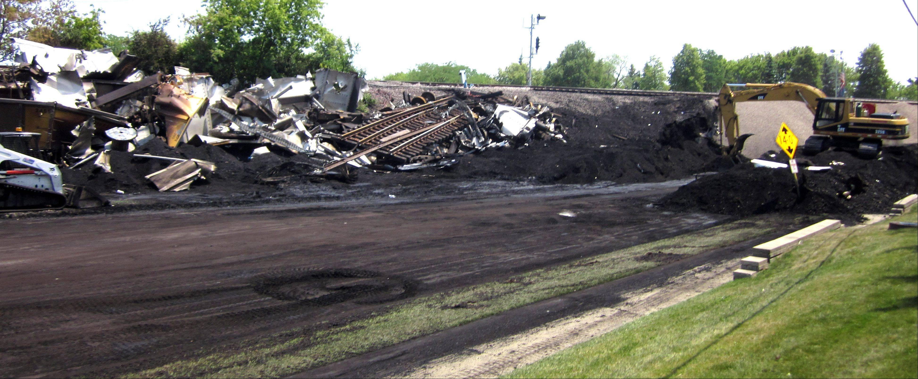 Machinery is at the scene two days after a fatal train derailment near Glenview.