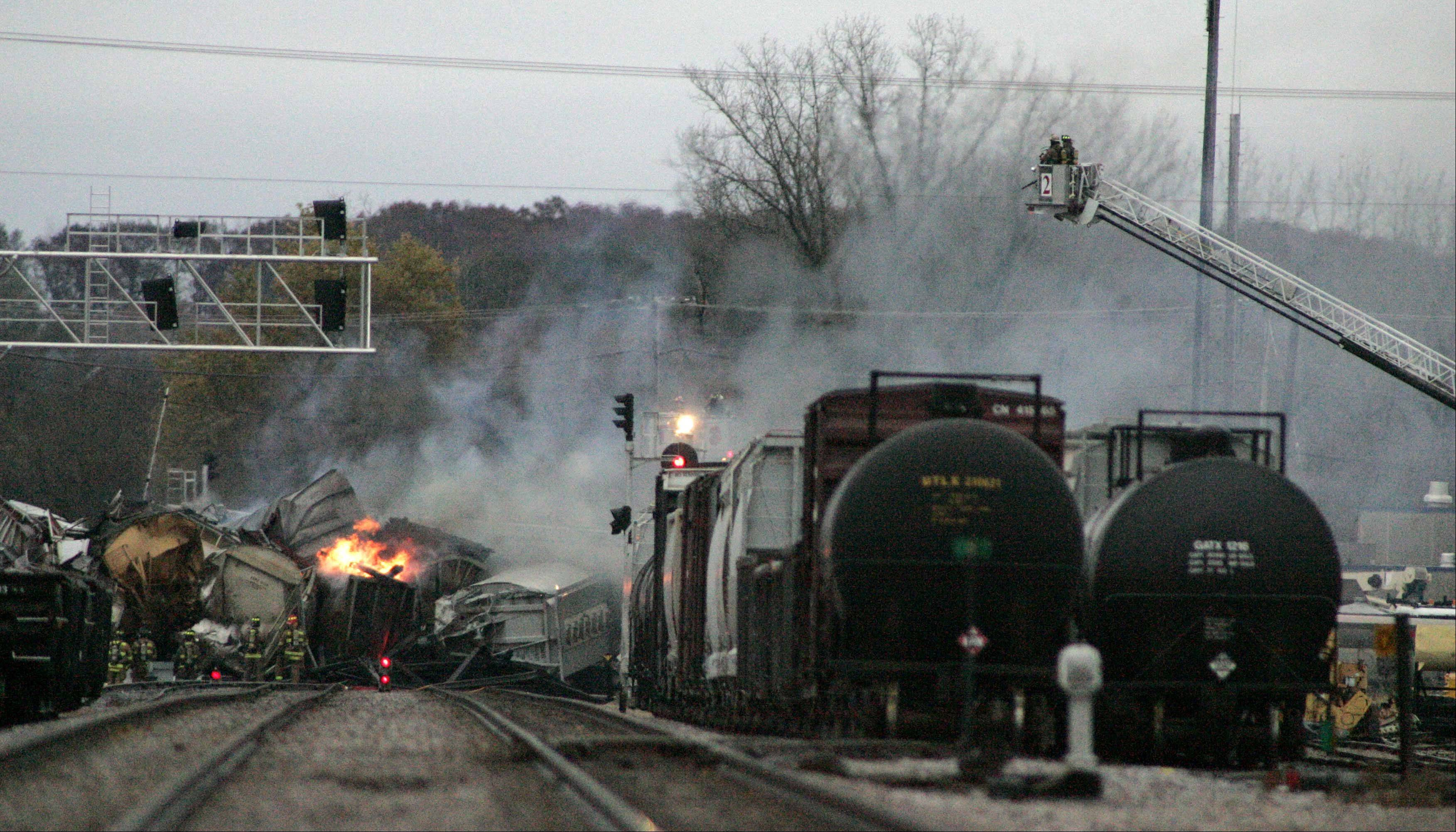 Smoke rises from a train derailment involving eight cars on the border of Elgin and Bartlett on Nov. 3, 2011.