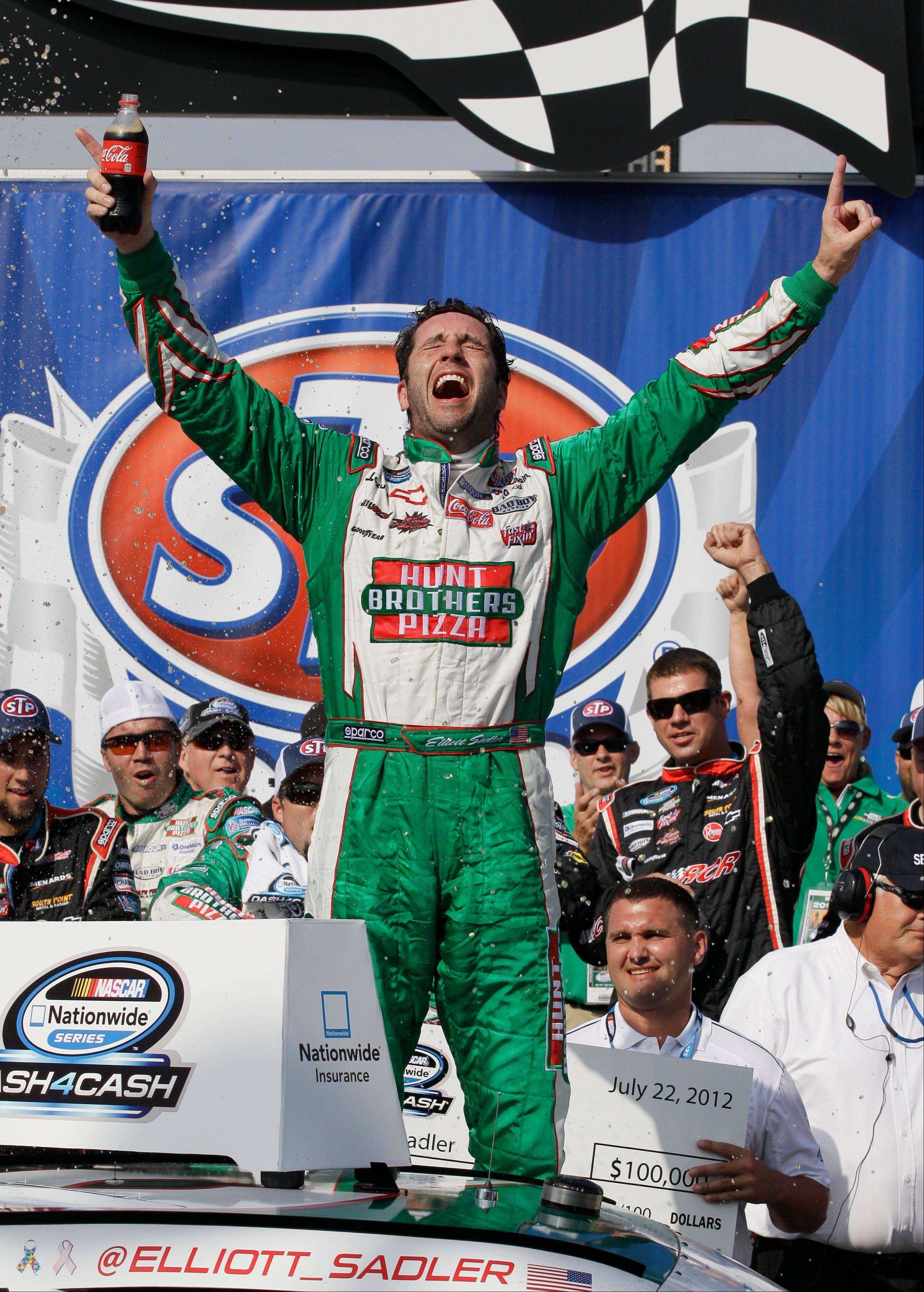 Elliott Sadler celebrates in victory lane after winning the NASCAR Nationwide Series auto race Sunday at Chicagoland Speedway in Joliet.