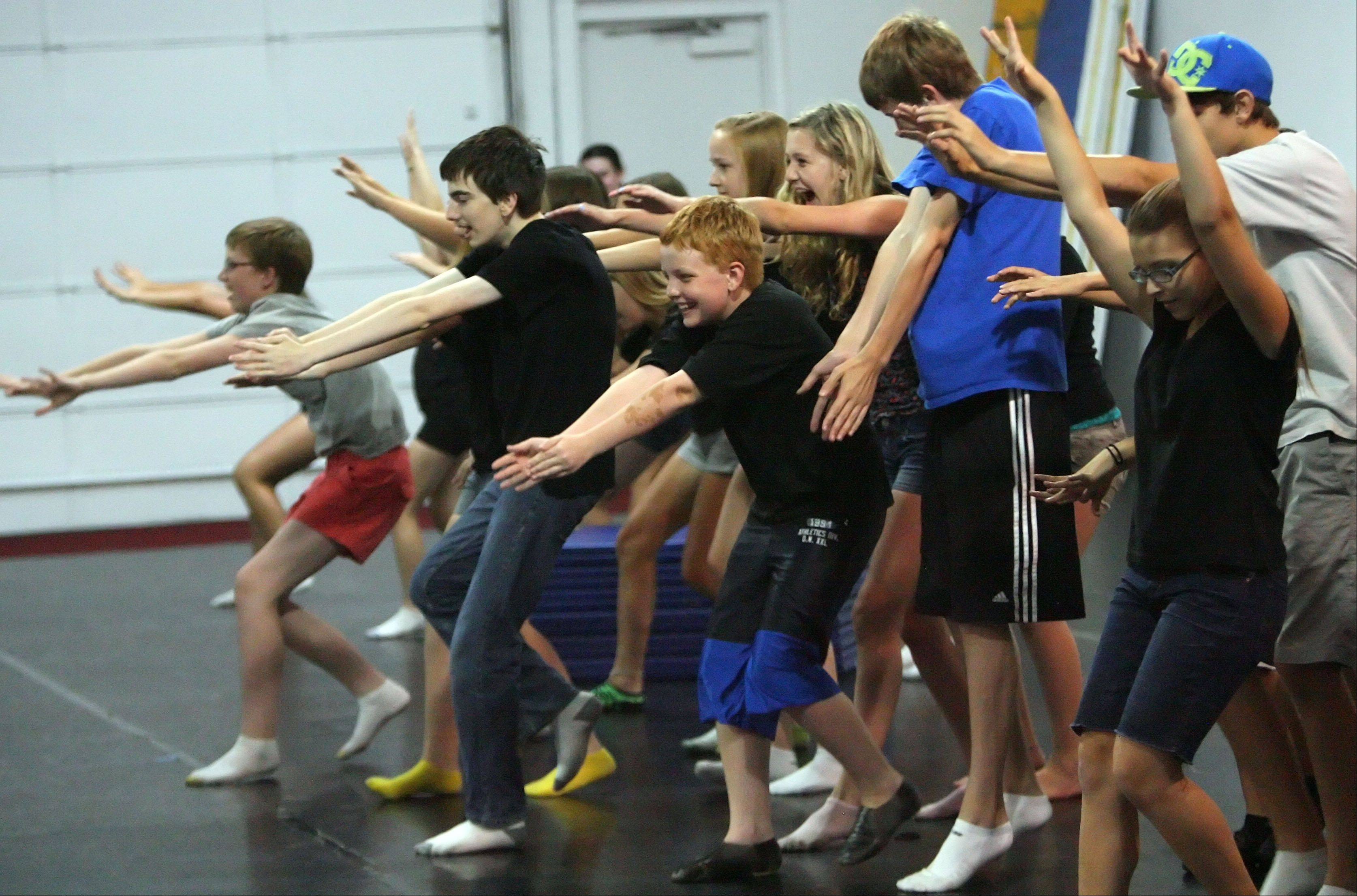 "The Ela Theater Company rehearse a dance routine for their production of ""Little Shop of Horrors."""
