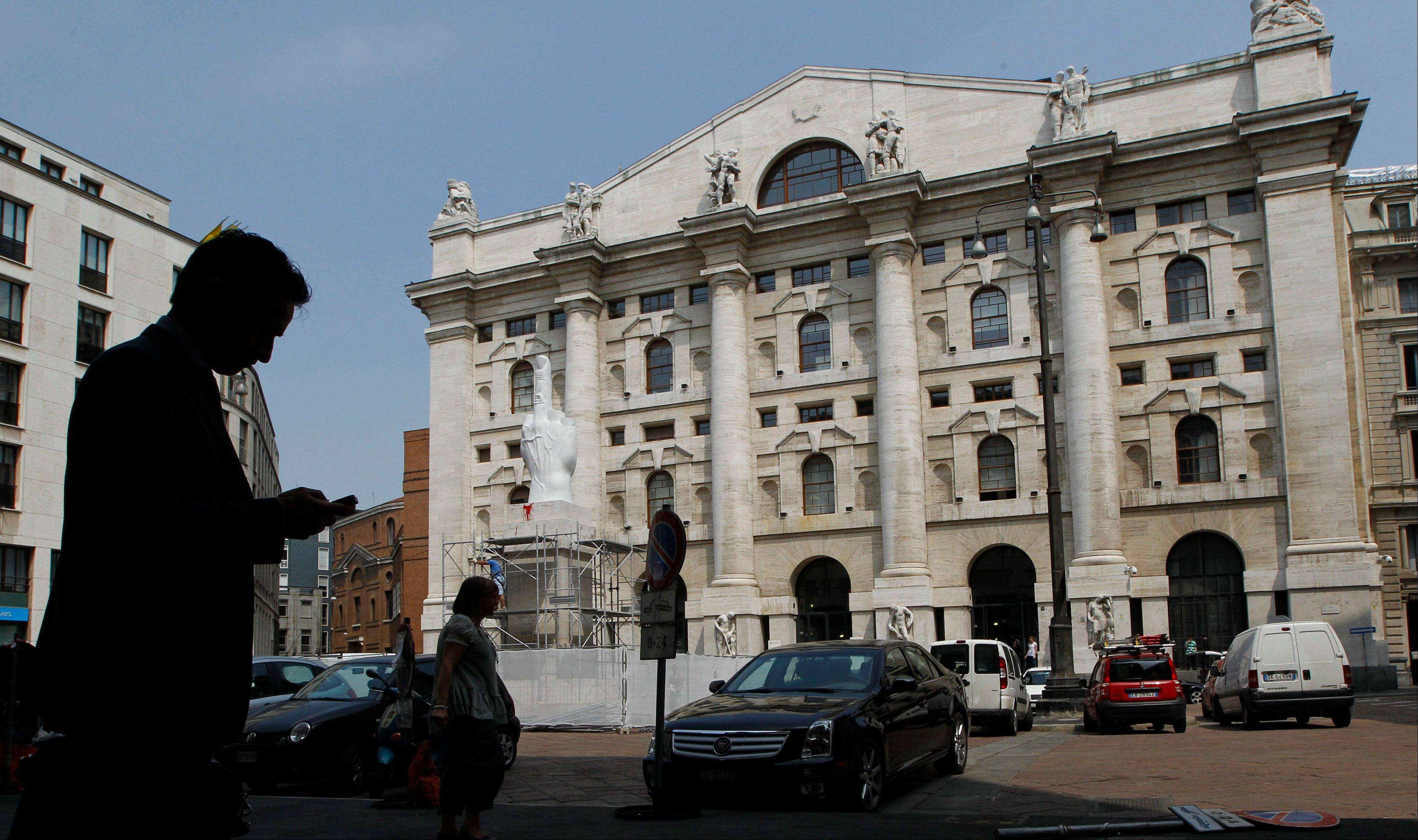 A man stands in front of the stock exchange market building in Milan, Italy. Italy�s market watchdog on Monday imposed a week-long ban on the short-selling of financial stocks as the Milan index plunged amid fears that if Spain needs a bailout, Italy could be next.