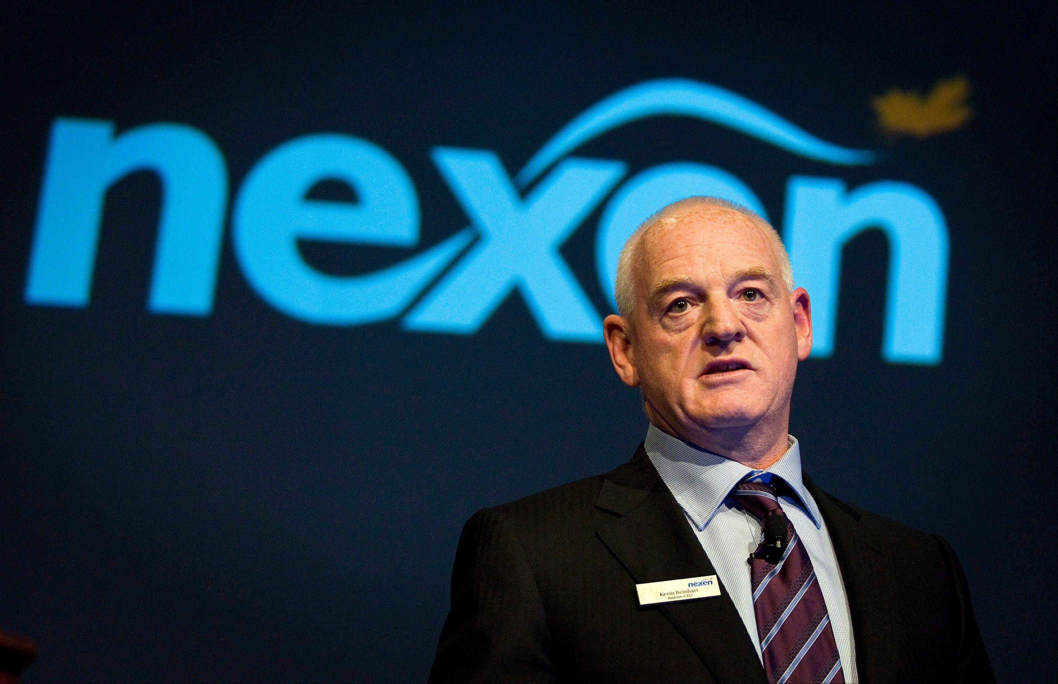 Nexen chief executive Kevin Reinhart addresses the company�s annual meeting in Calgary, Alberta, on April 25. Oil and gas producer Nexen Inc. has agreed to be acquired by China National Offshore Oil Company for $15.1 billion.