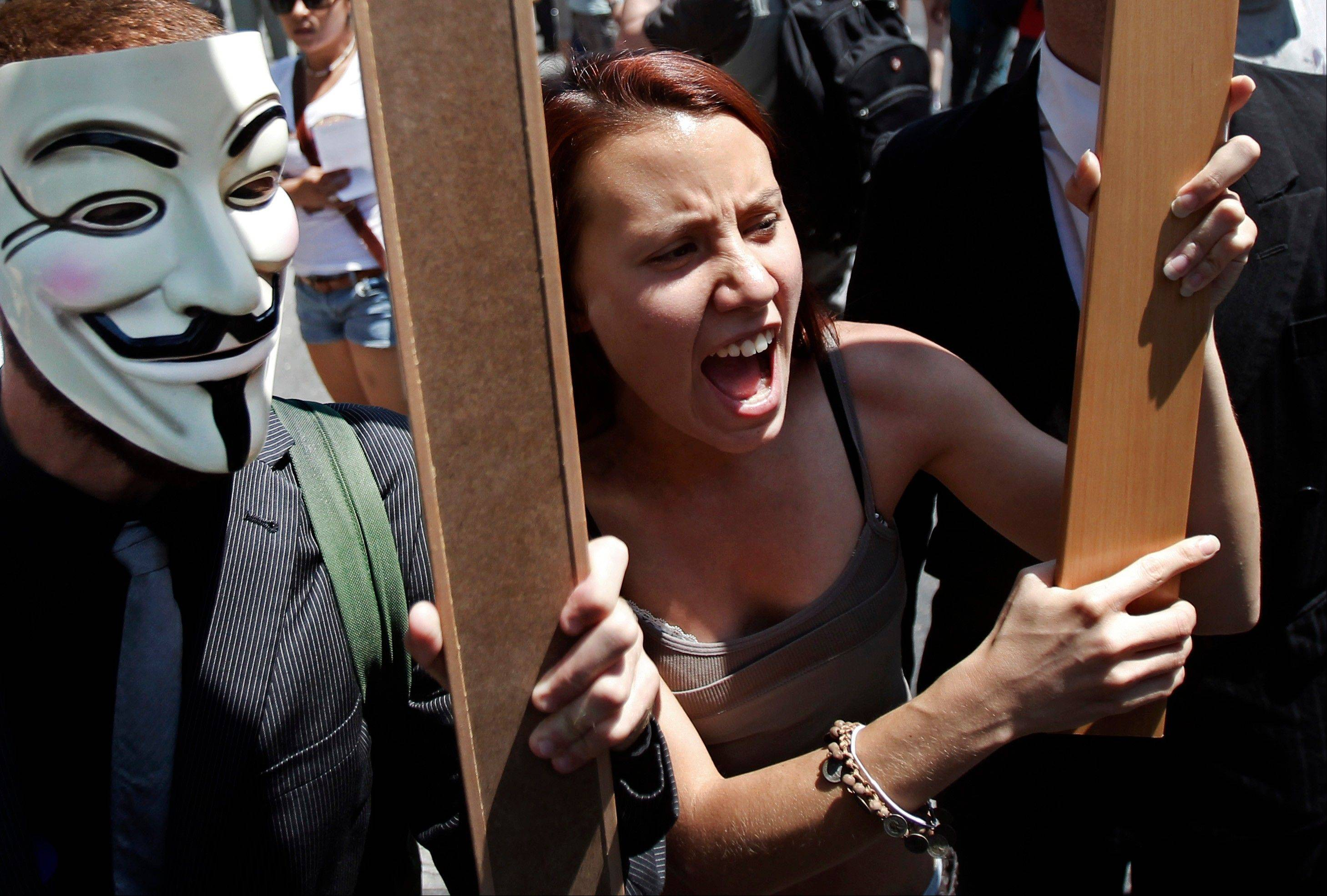Protesters shout slogans to demonstrate against the country�s near 25 percent unemployment rate and stinging austerity measures introduced by the government, in Madrid, Spain.