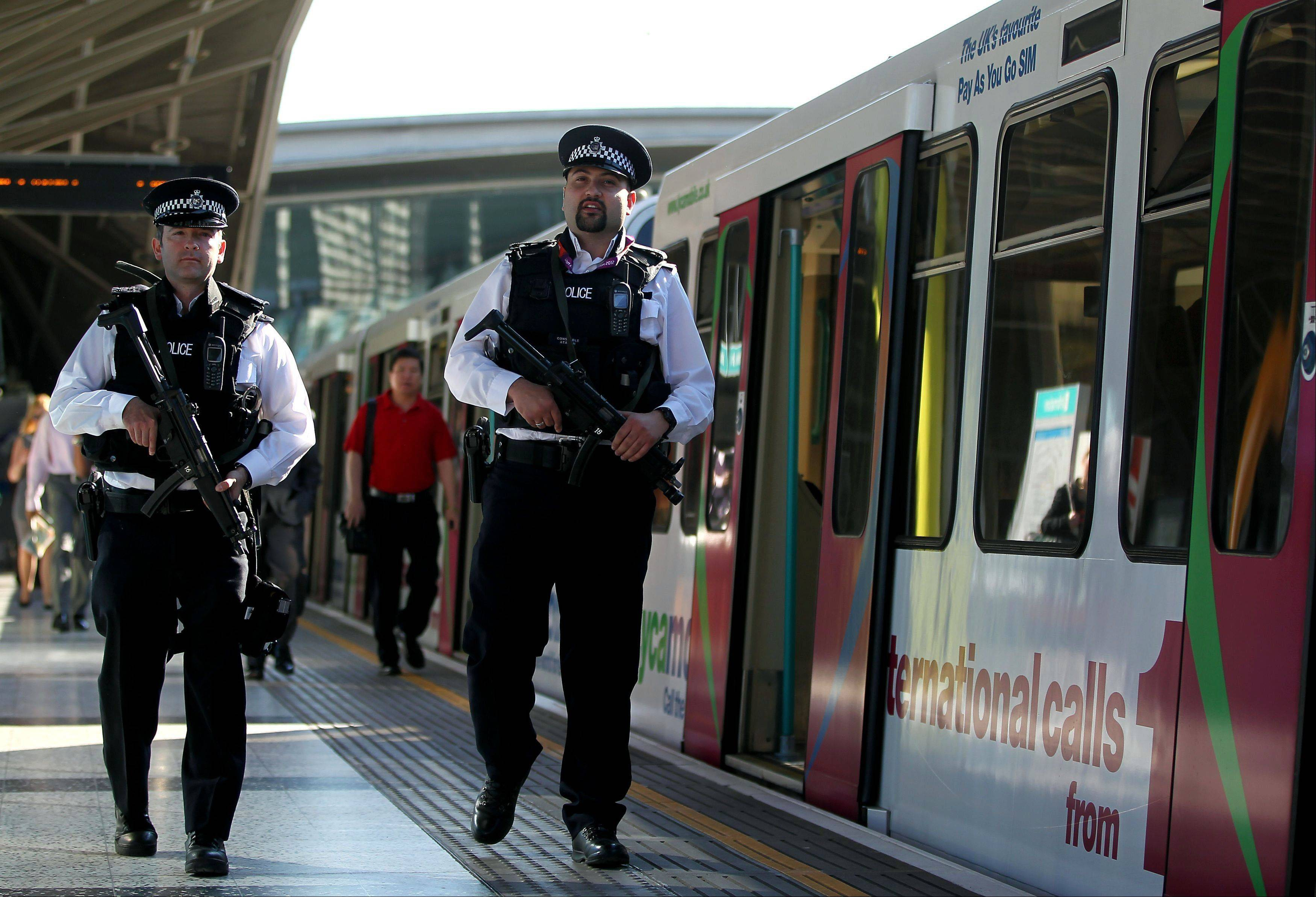Armed police officers patrol at Stratford station near the Olympic Park on Monday in London. The city will host the 2012 Summer Olympics which opens Friday.