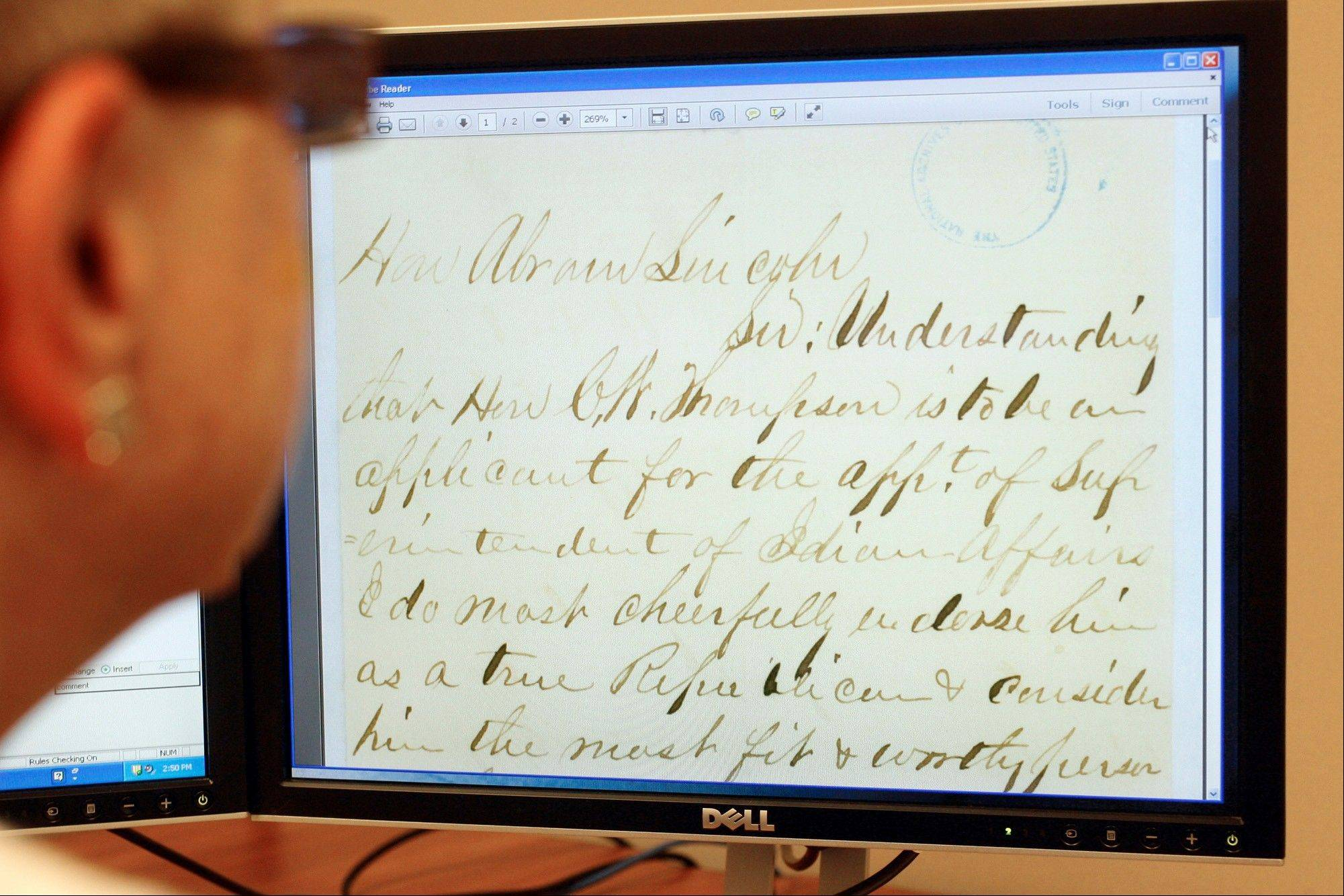 "Joan Walters studies a letter written to Abraham Lincoln as she transcribes it at the Papers of Abraham Lincoln at the Abraham Lincoln Presidential Library in Springfield, Ill. Walters said the letters all have varying degrees of grammar, punctuation and shorthand, as evidenced by the greeting, ""Hon Abram Lincoln."""