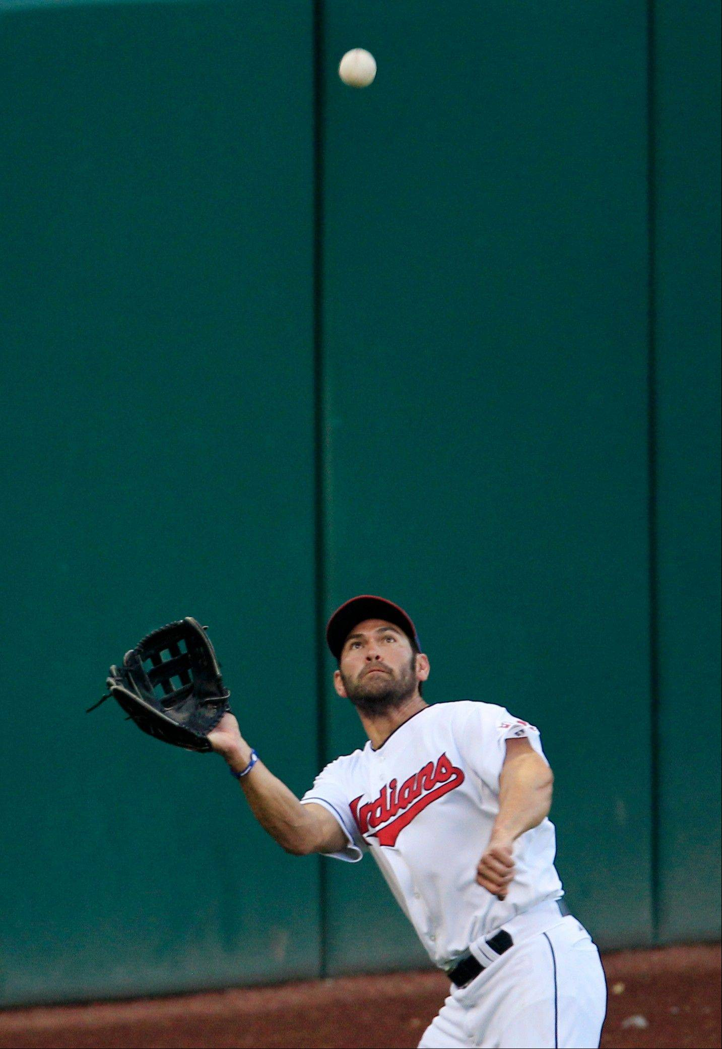 The Indians� Johnny Damon keeps his eyes on a fly ball hit by the Orioles� Wilson Betemit in the fifth inning Monday in Cleveland.