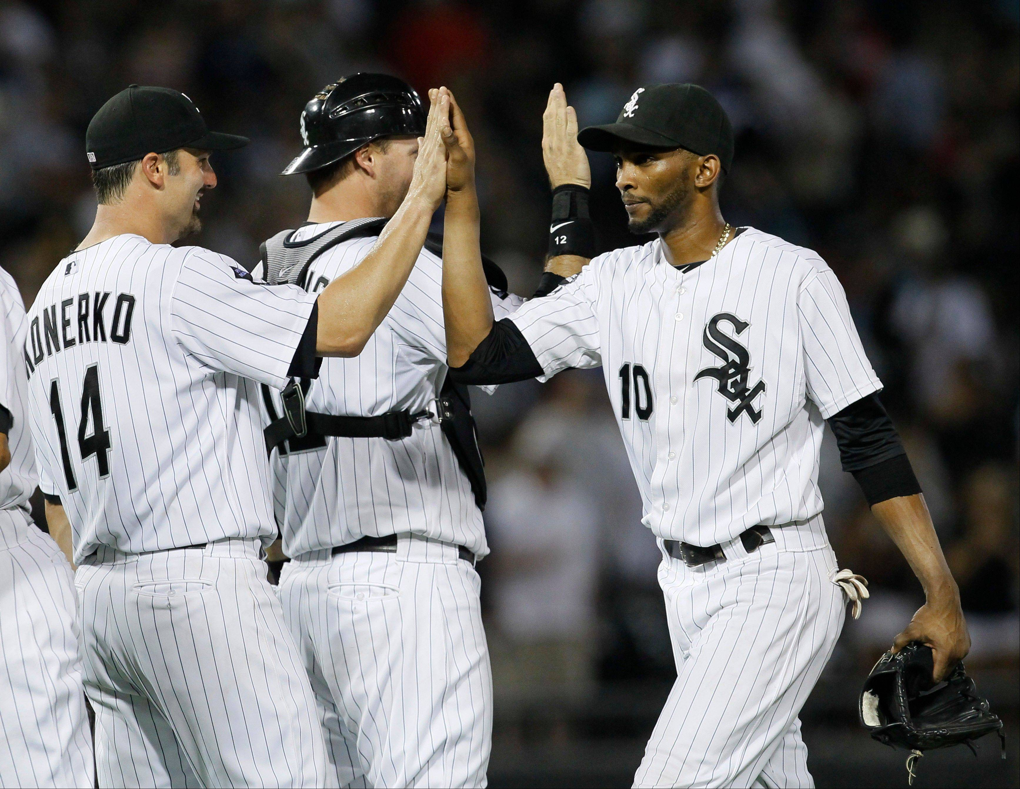 White Sox first baseman Paul Konerko, catcher A.J. Pierzynski and shortstop Alexei Ramirez celebrate Monday night's victory. Konerko got the offense rolling with a 3-run homer in the first inning