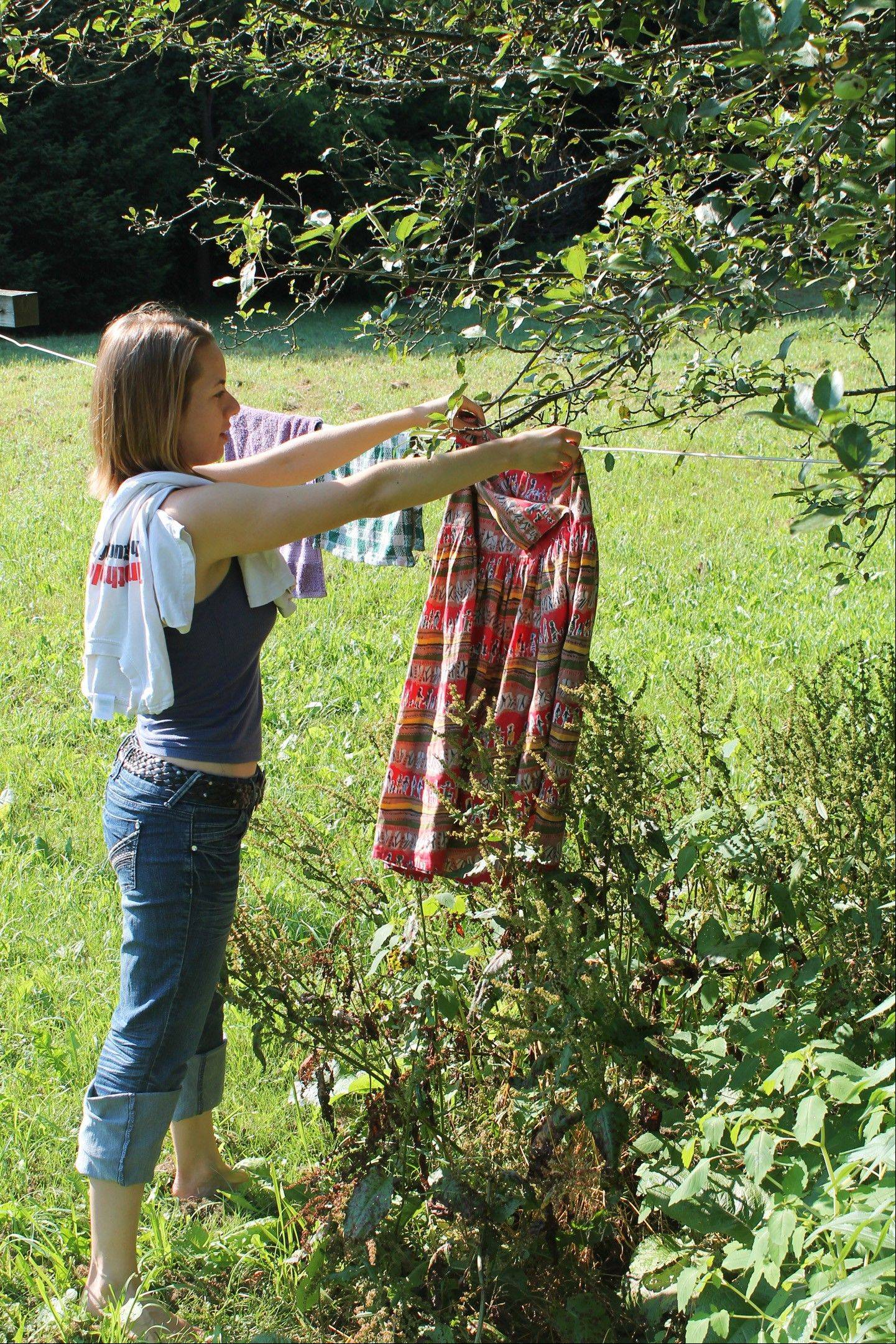 "Abigail Gehring hangs laundry outside her home in West Brattleboro, Vt. Gehring is the author and editor of several books on green living skills, including ""The Illustrated Encyclopedia of Country Living"" and ""The Homesteading Handbook,"" both from Skyhorse Publishing."