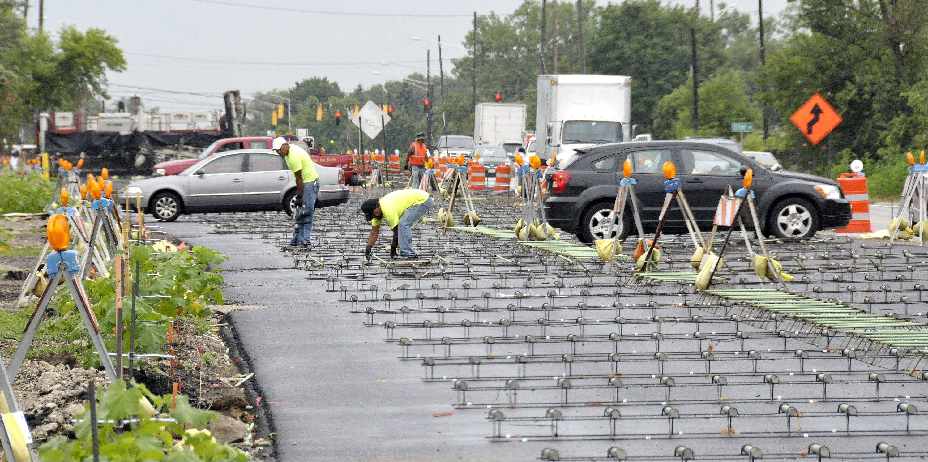 Work continues on resurfacing of Route 53 in Addison and Itasca. Here, workers install reinforcements for new pavement north of Army Trail Road.
