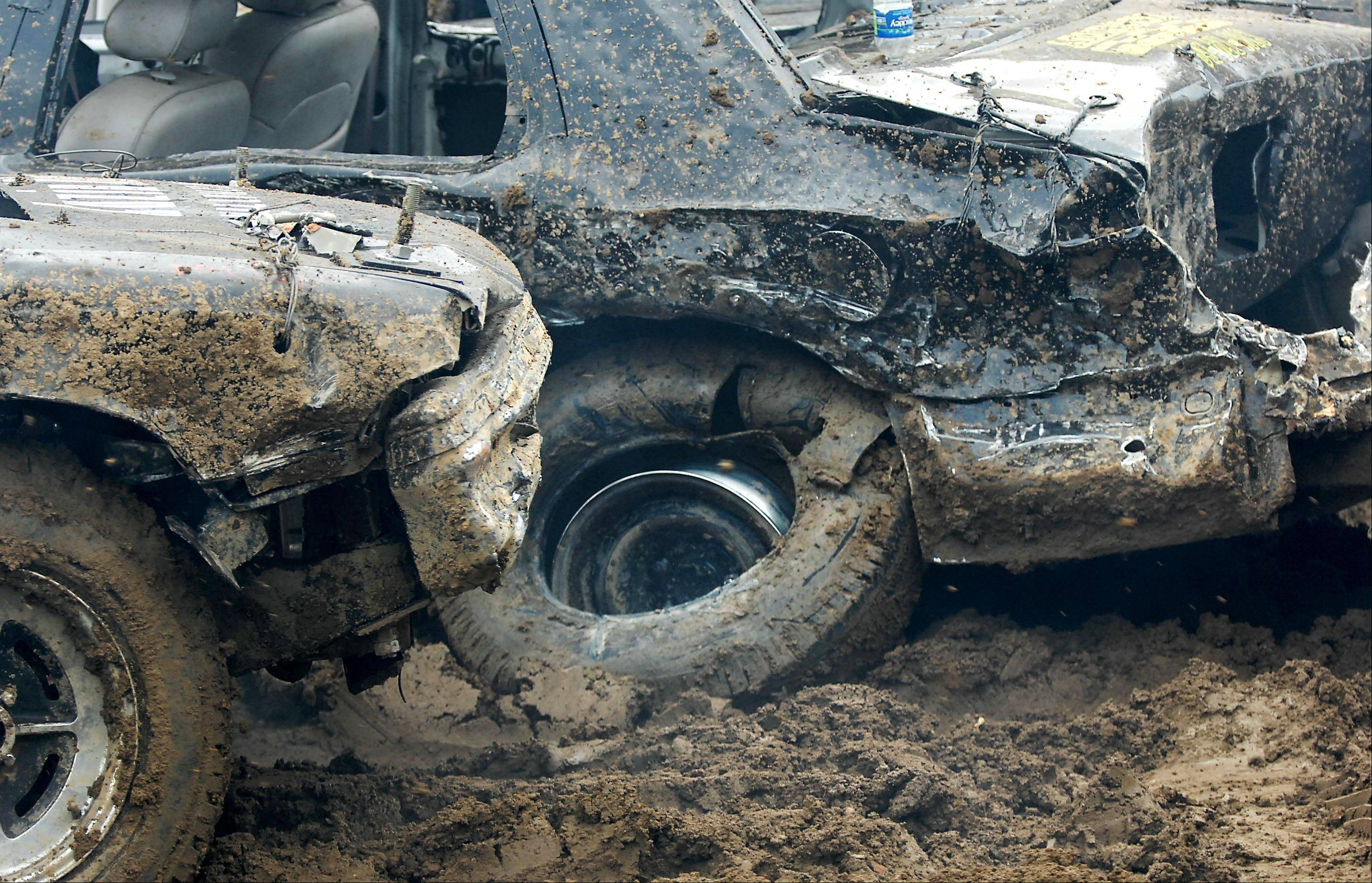 Cars continue until they cannot move in the Demolition Derby at the Kane County Fair Sunday in St. Charles.