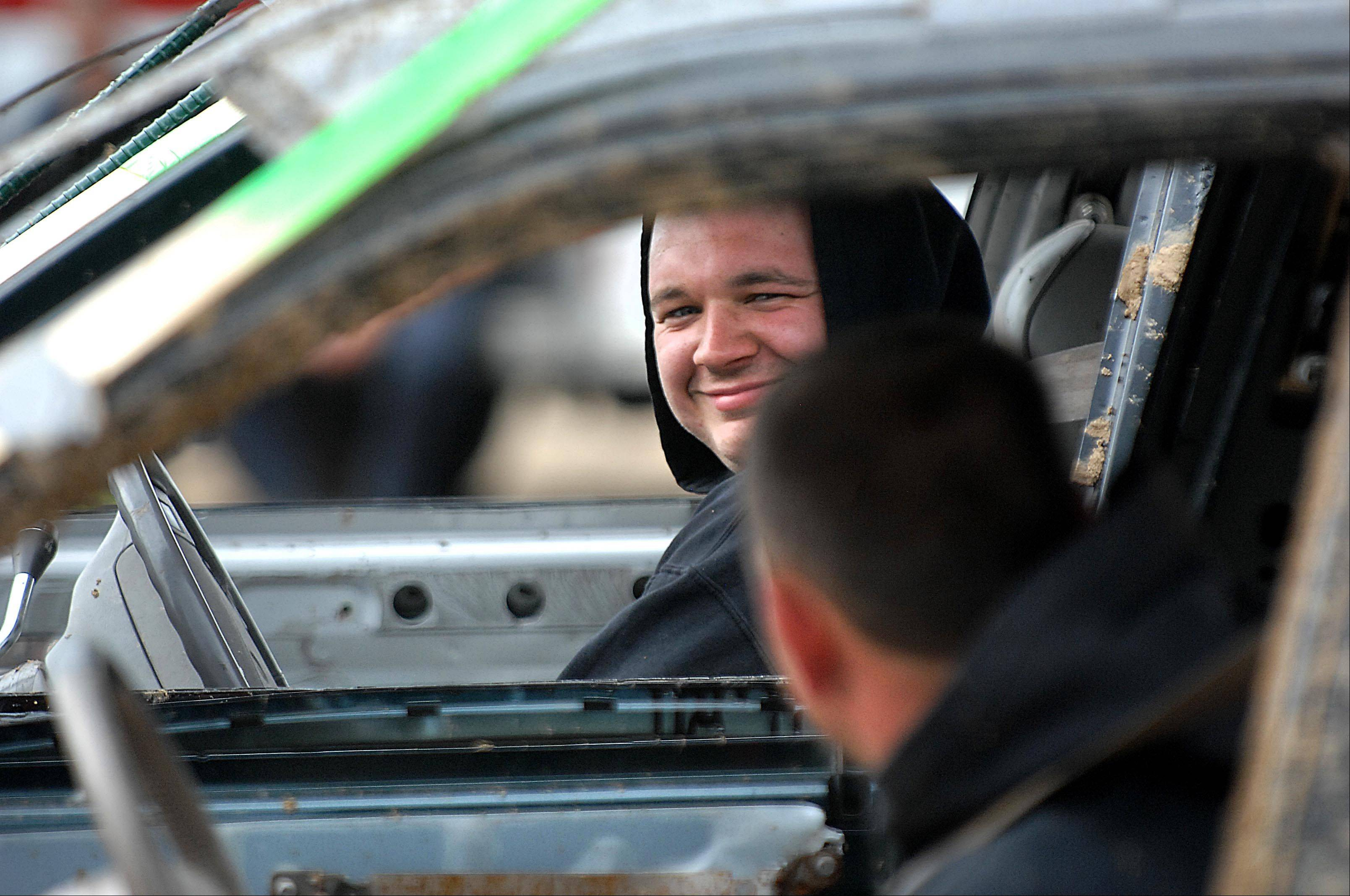 Michael Brancecum of St. Charles laughs with Randy Ellis of Belvidere before the Championship heat of the Demolition Derby at the Kane County Fair Sunday in St. Charles. Ellis won the event.