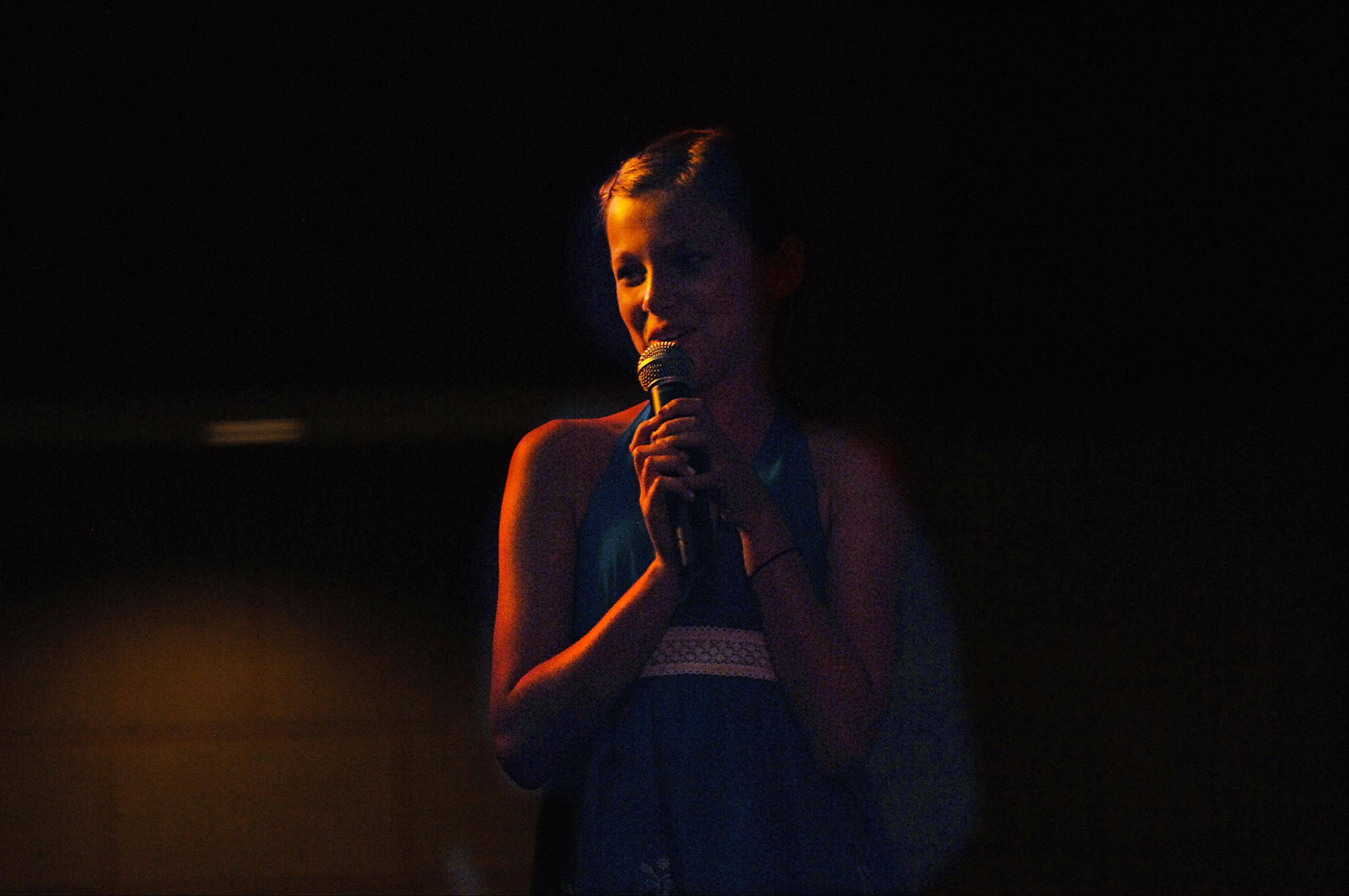 Eleven-year-old Kiersten Larsen sings What It Means To Be A Friend onstage Monday night at the 29th Annual Kane County Fair Talent Contest in the Prairie Events Center at the fairgrounds in St. Charles. She is from South Elgin.