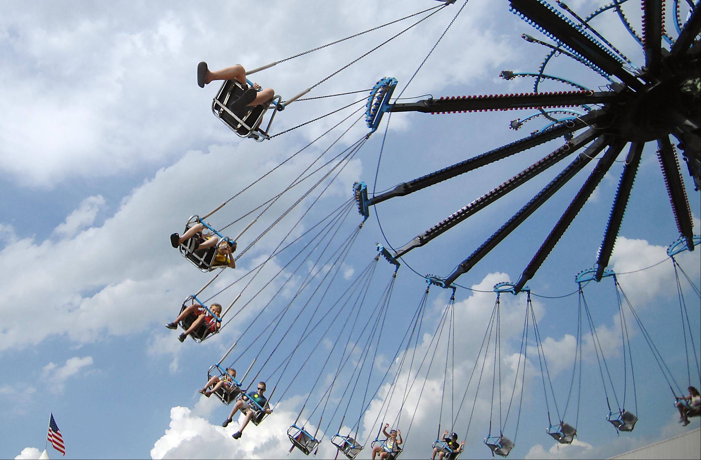 Yo-Yo riders enjoy the cool breeze on the first day of the Kane County Fair Wednesday in St. Charles.