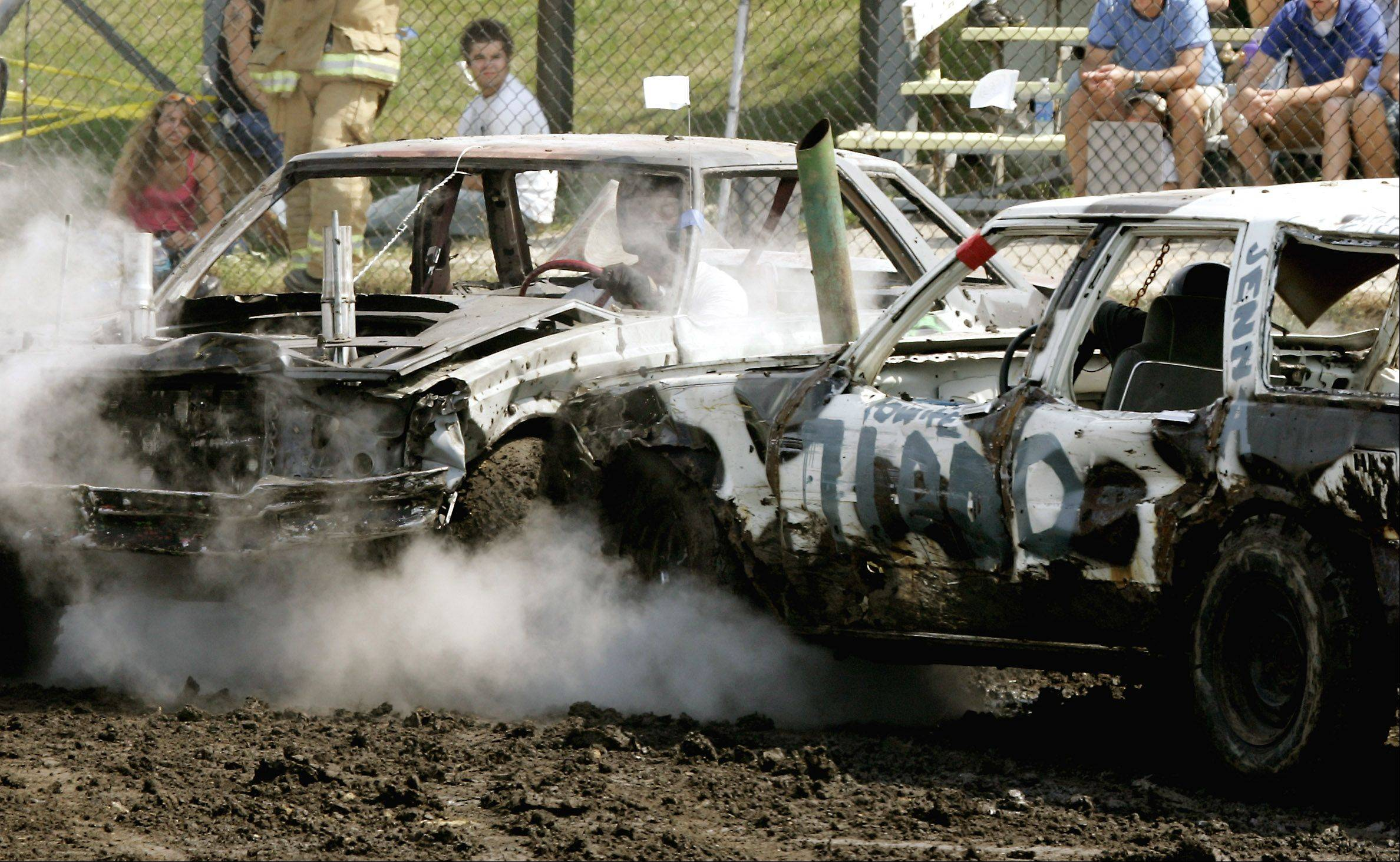 2005: Dwight Fernald of Lombard, right, crashes into another car during the Demolition Derby.