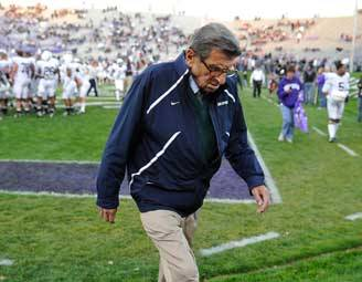 In this Oct. 22, 2011 file photo, Penn State coach Joe Paterno walks off the field after warmups before an NCAA college football game against Northwestern in Evanston.