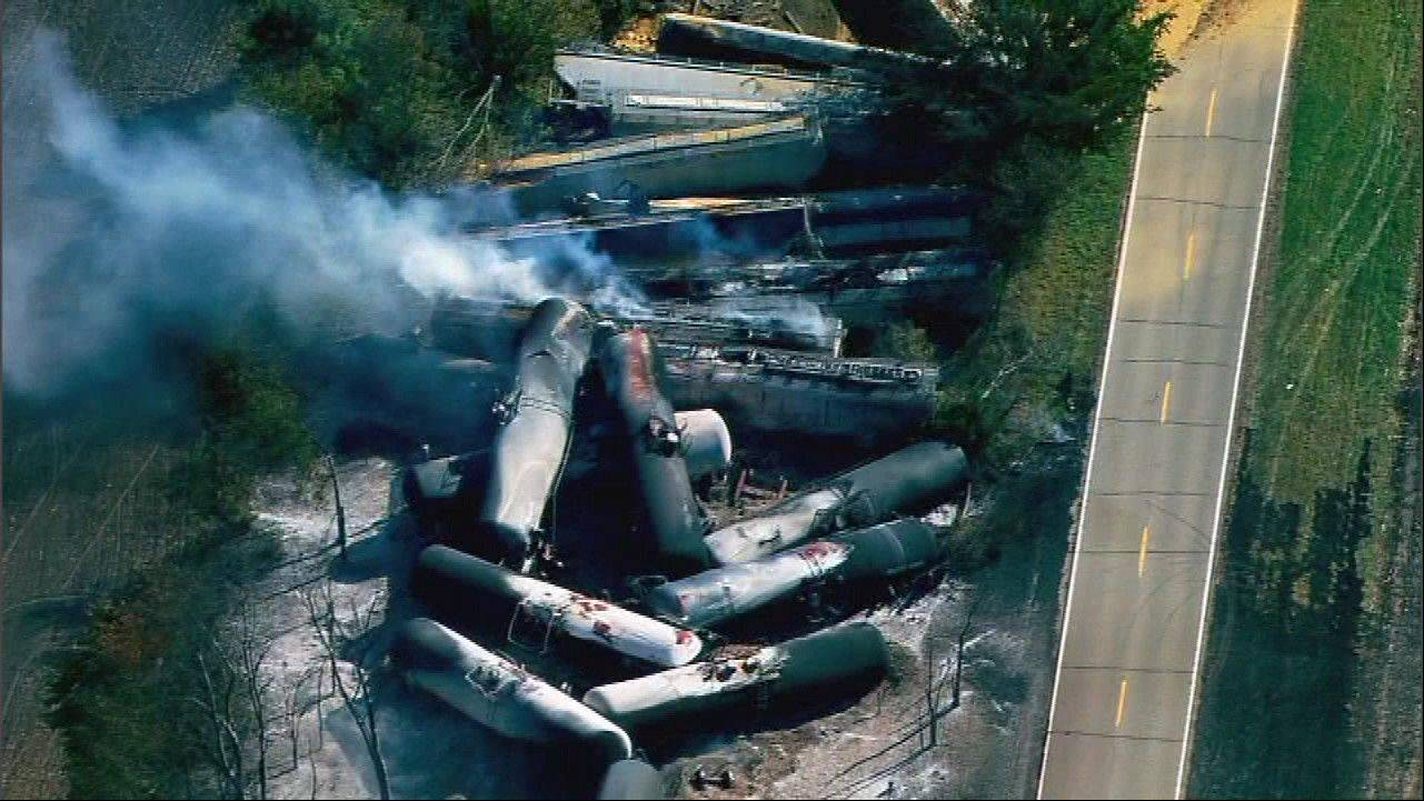 Rail cars burn after a hazardous materials spill caused by a derailment in Tiskilwa in October.