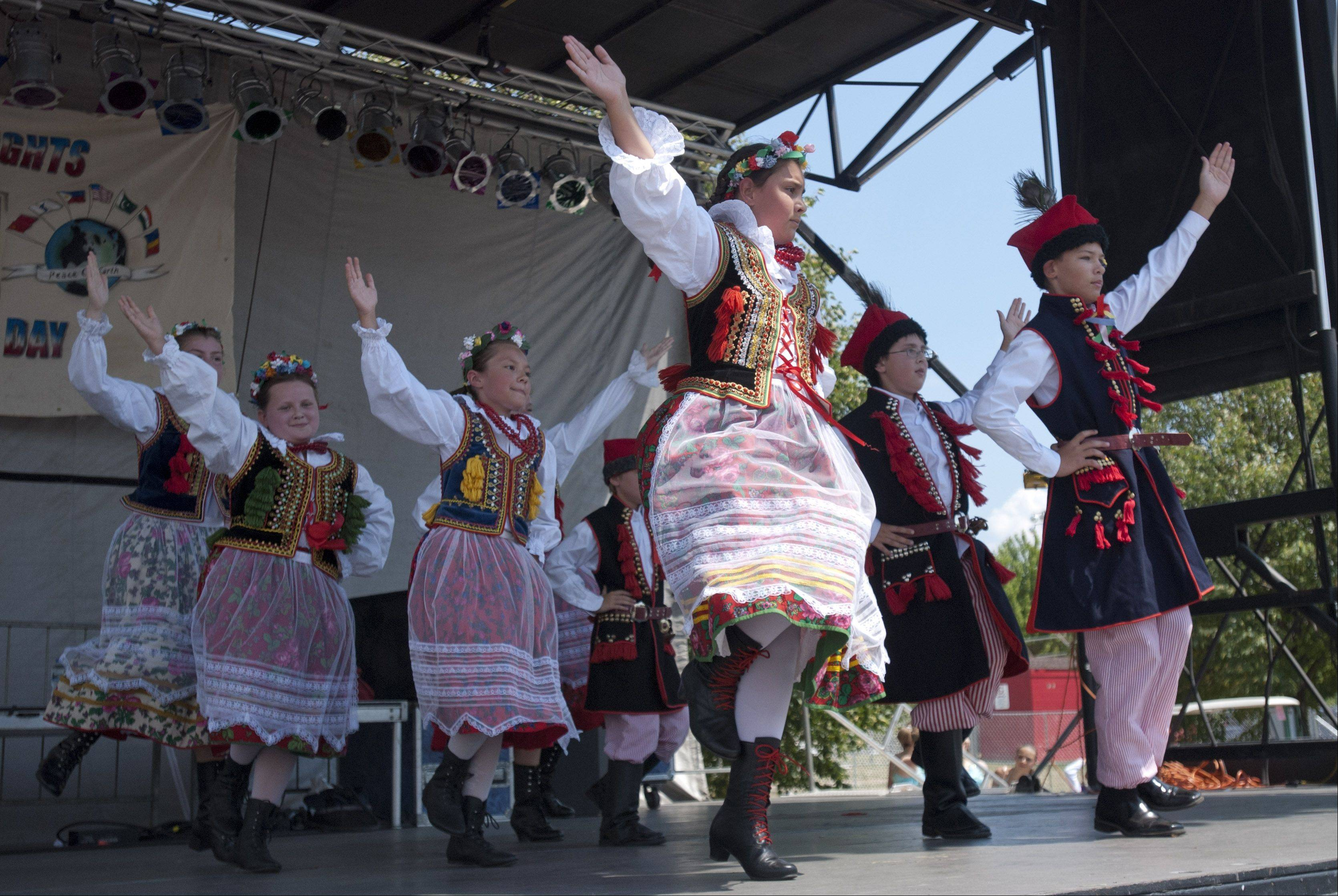 Members of the Addison park district Polish Dance Group perform during International Day at Glendale Heights' festival at Camera Park.