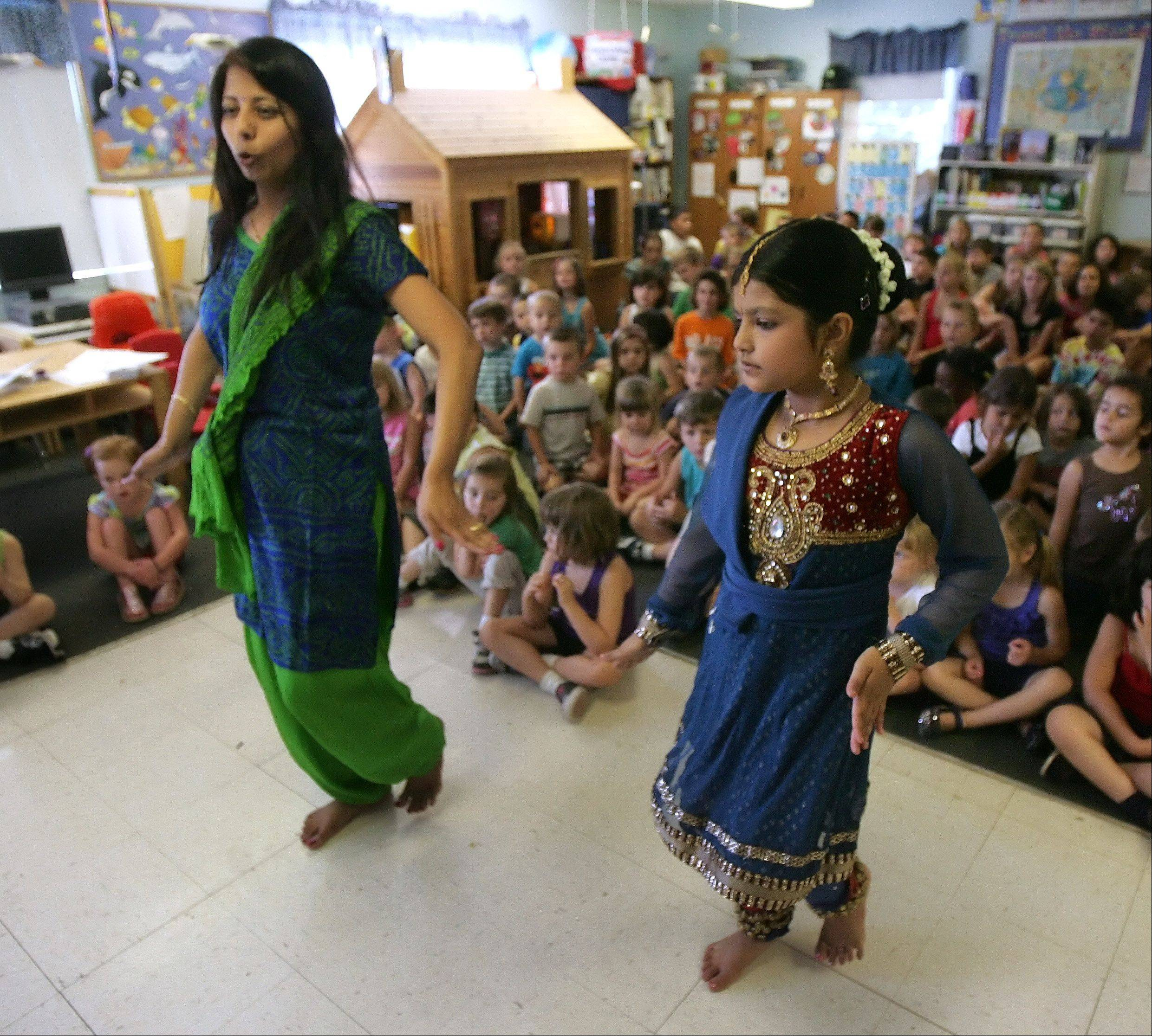 "Gauri Jog, of Gauri Jog Indian Dance School in Schaumburg, and her student, Ruchi Patel, 9, demonstrated different traditional Indian dances for students at the Lindenhurst Early Childhood Center Tuesday. Wearing traditional attire, Jog showed the students how to move during her visit that was part of the school's summer program '""Trip Around the World."""