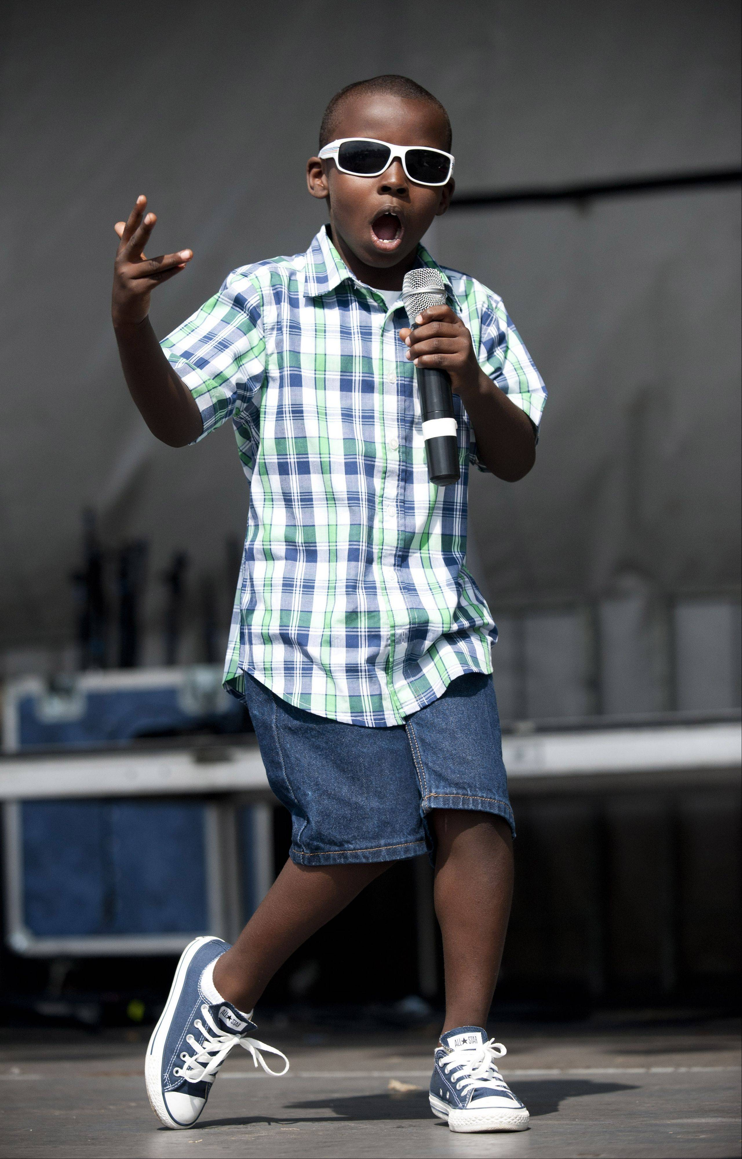 "Ryan Williams, 7, competes in the ""Glendale Idol"" during the Glendale Heights Festival on Saturday"