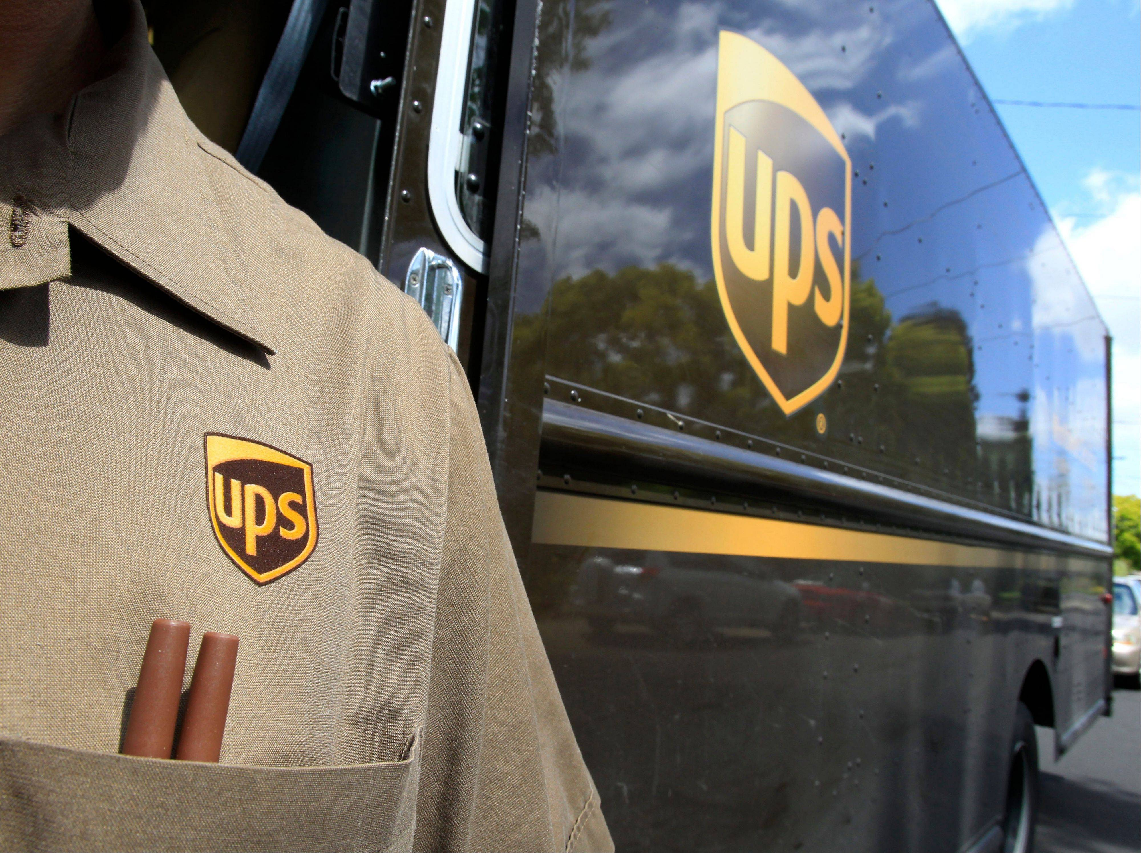 United Parcel Service lowered its earnings expectations for the year on Tuesday as economic weakness and uncertainty persist around the globe.
