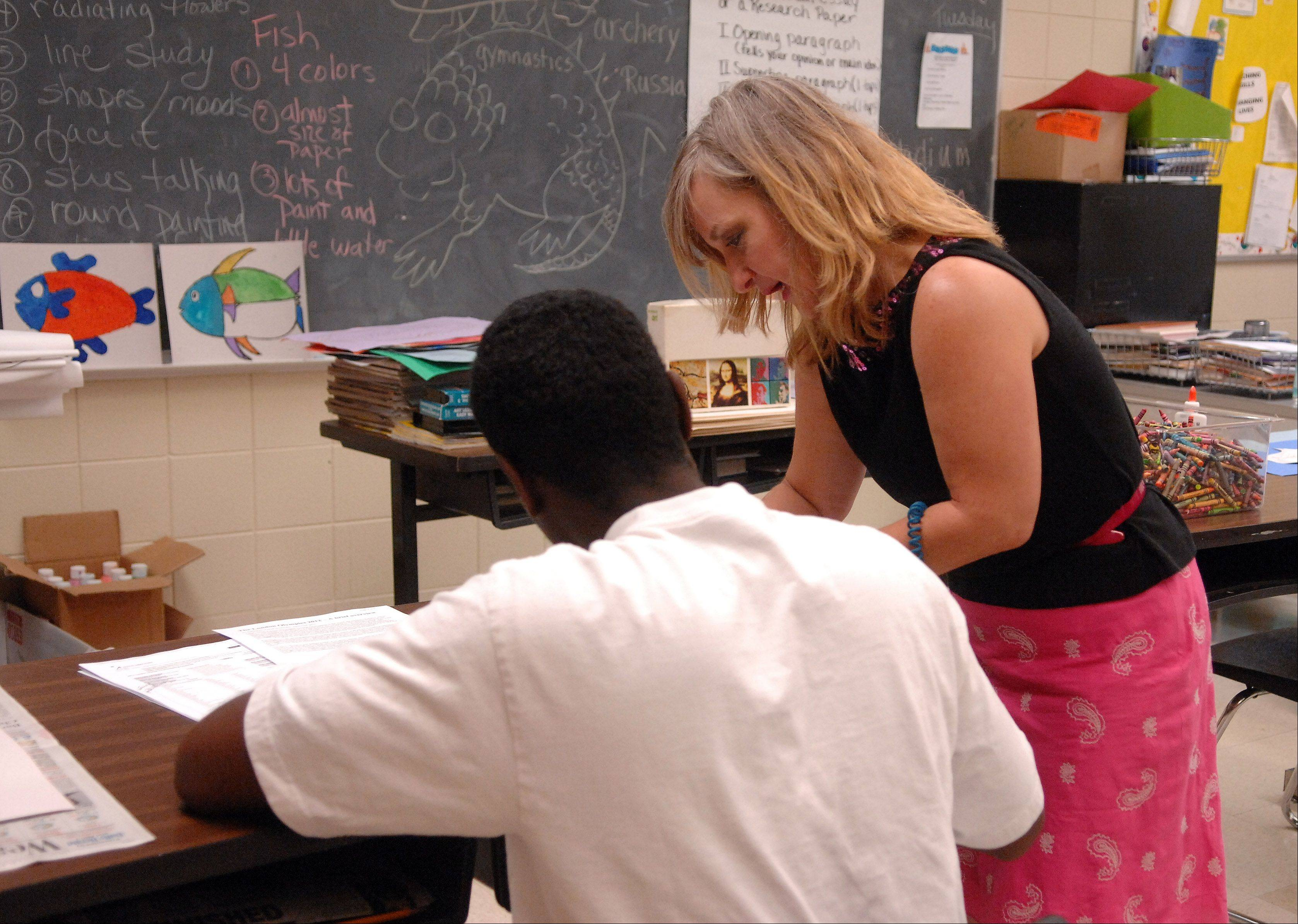 Teacher Dolly McComb works with a student at the Larkin Center School in Elgin Tuesday. Larkin Center School has been selected as a School of Excellence by the National Association of Special Education Teachers, the highest honor that can be bestowed on a private school by the professional association.