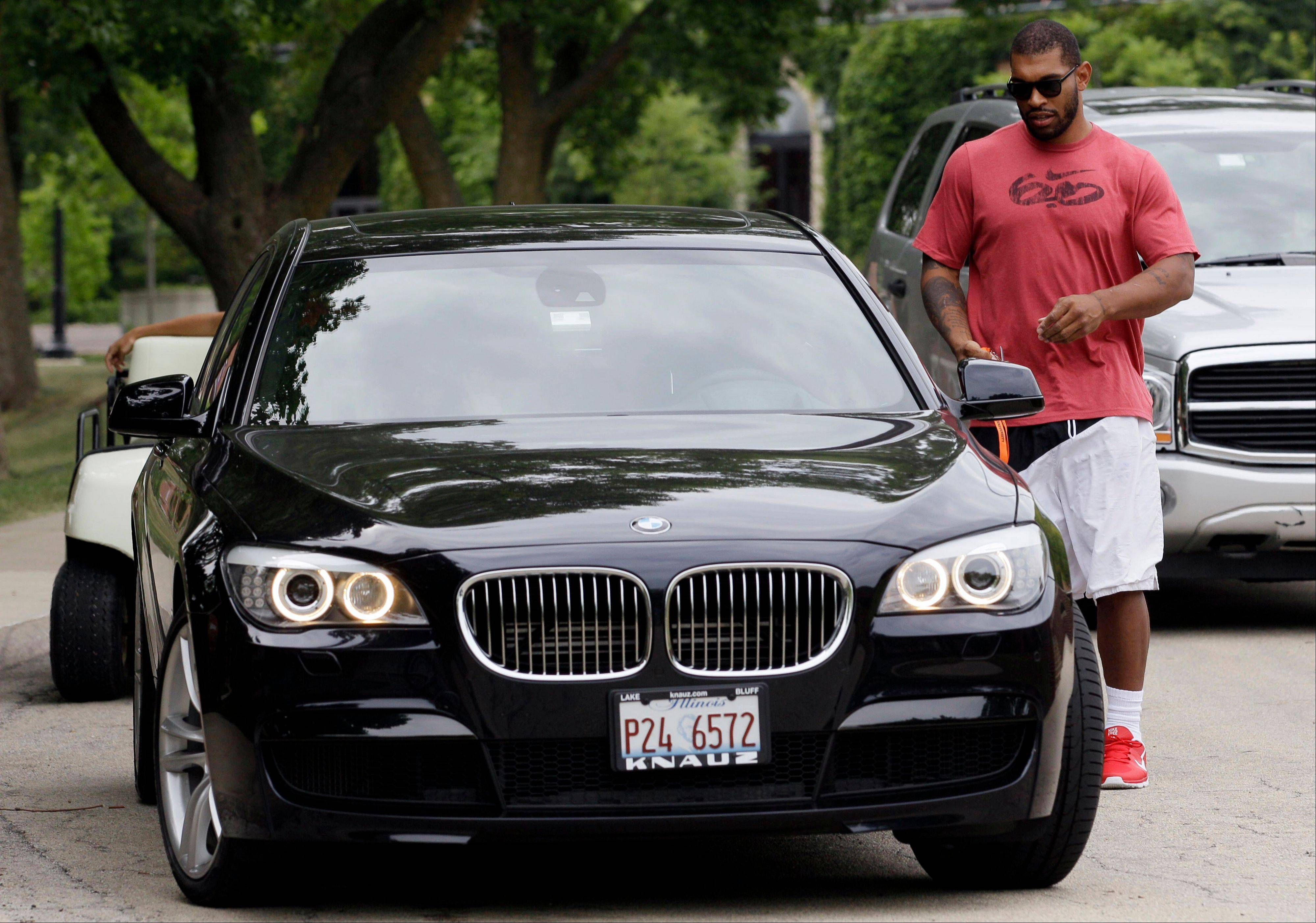 Chicago Bears defensive end Julius Peppers arrives at NFL football training camp at Olivet Nazarene University in Bourbonnais, Ill., Tuesday, July 24, 2012. (AP Photo/Nam Y. Huh)