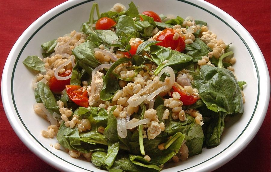 Barley provides fiber and texture to a salad of spinach, shallots, tofu and tomatoes. Enjoy this warm or cold.