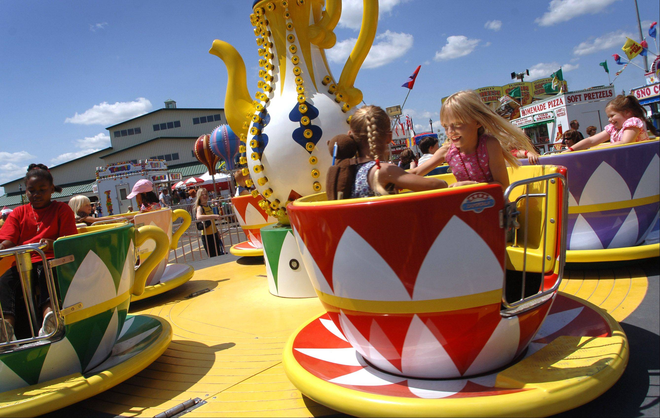 Kids enjoy the teacup ride at a previous year's Lake County Fair in Grayslake.