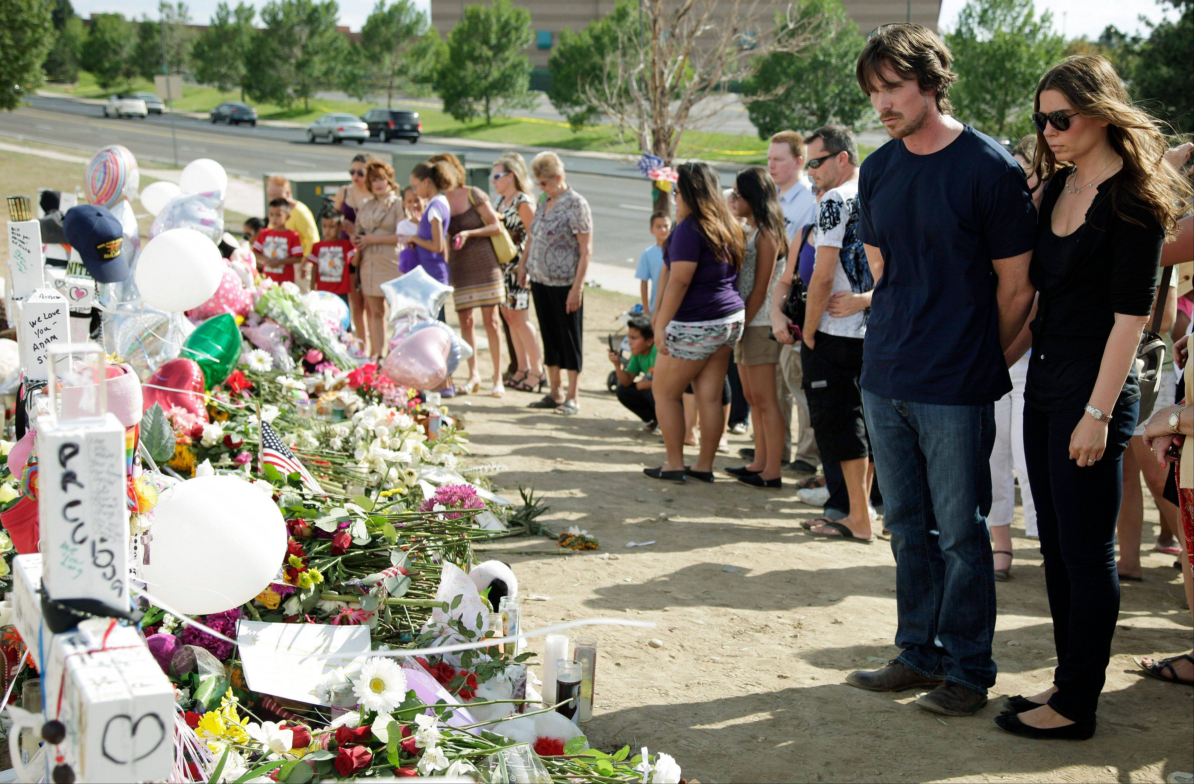 "Actor Christian Bale and his wife Sibi Blazic came to Colorado Tuesday to visit a memorial to the victims of Friday's mass shooting. Twelve people were killed when a gunman opened fire during a late-night showing of the movie ""The Dark Knight Rises,"" which stars Bale as Batman."