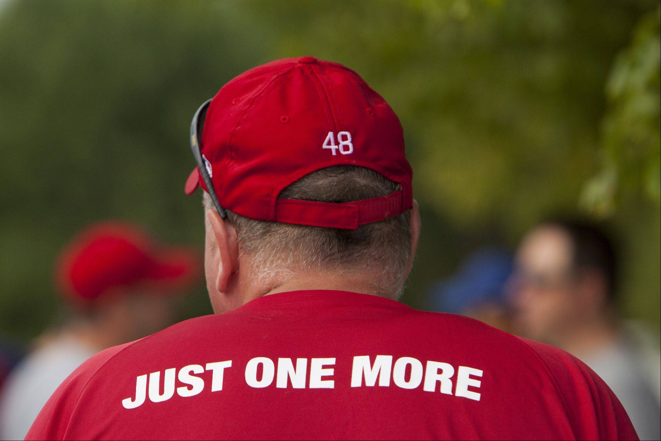 "Paul Williams, the organizer for the Bartlett Little League Challenger Division, wears a shirt that reads ""Just one more"" on the back."