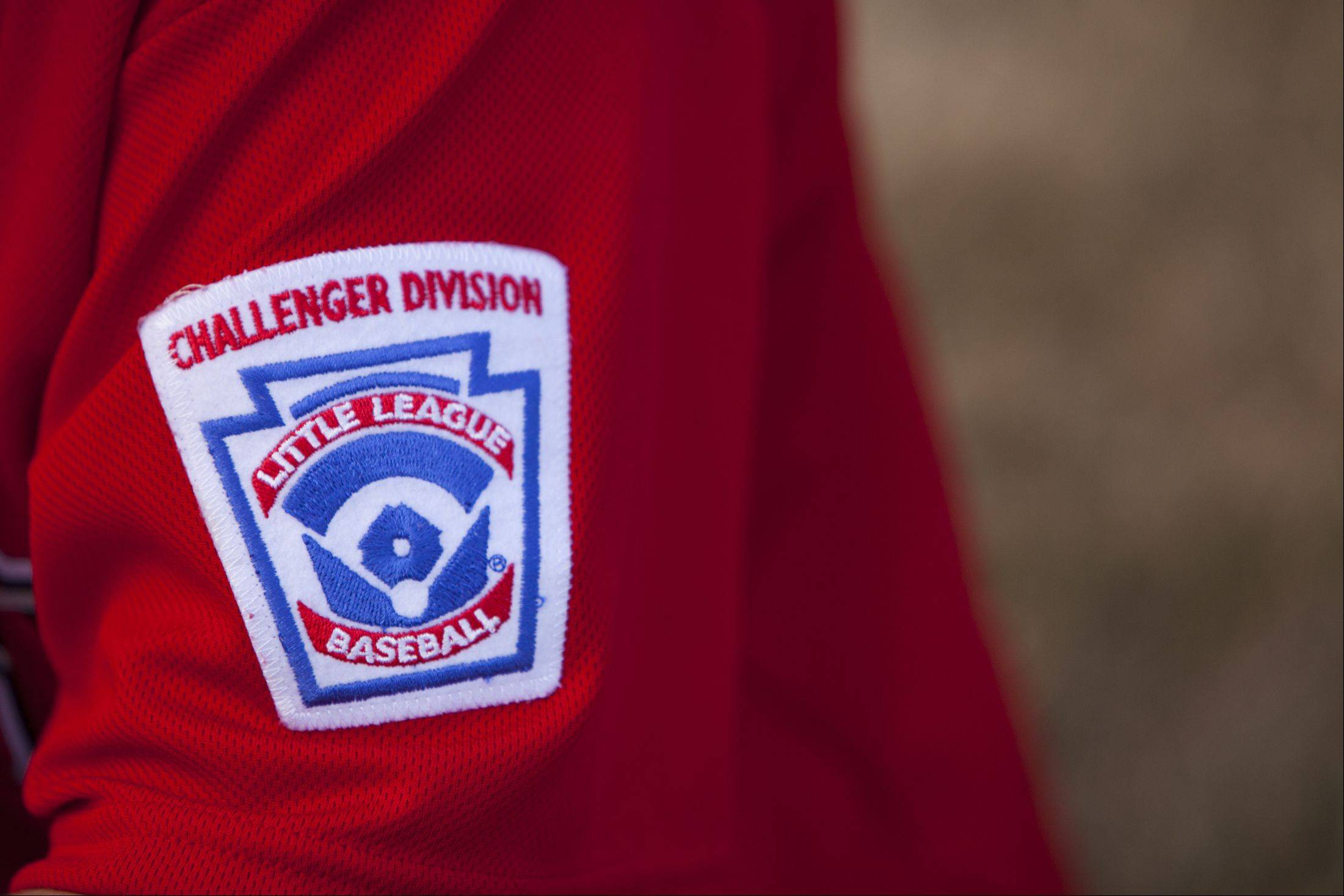 The Bartlett Little League Challenger Division patch is worn on all the players' jerseys.