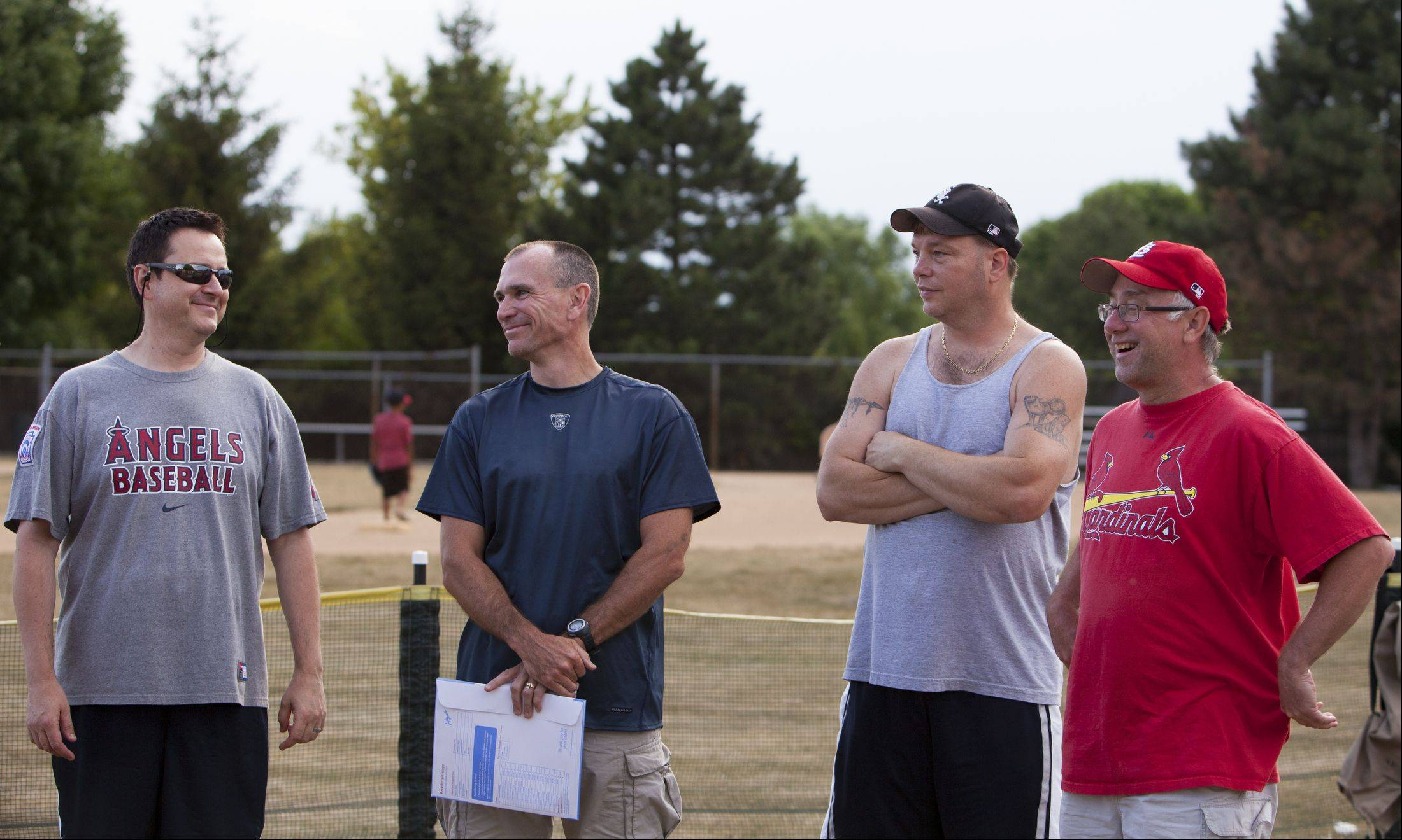 Bartlett Little League Challenger coaches, from left, Larry Wegner, of the Angels and league member for eight years, Mike Miles, of the Cubs and league member for 10 years, Bob Kennedy, of the Sox and league member for four years, and Larry Lavoie, of the Cardinals and league member for six years, are recognized for their hard work.