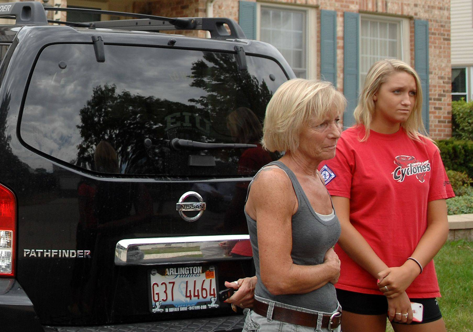 Debbie Vojtsek speaks to the media outside the home of her niece, Julia Vojtsek, Monday in Algonquin. Julia said her boyfriend, John Larimer of Crystal Lake, saved her life by shielding her from the bullets that claimed him and 11 others in the movie theater shooting Friday in Colorado.