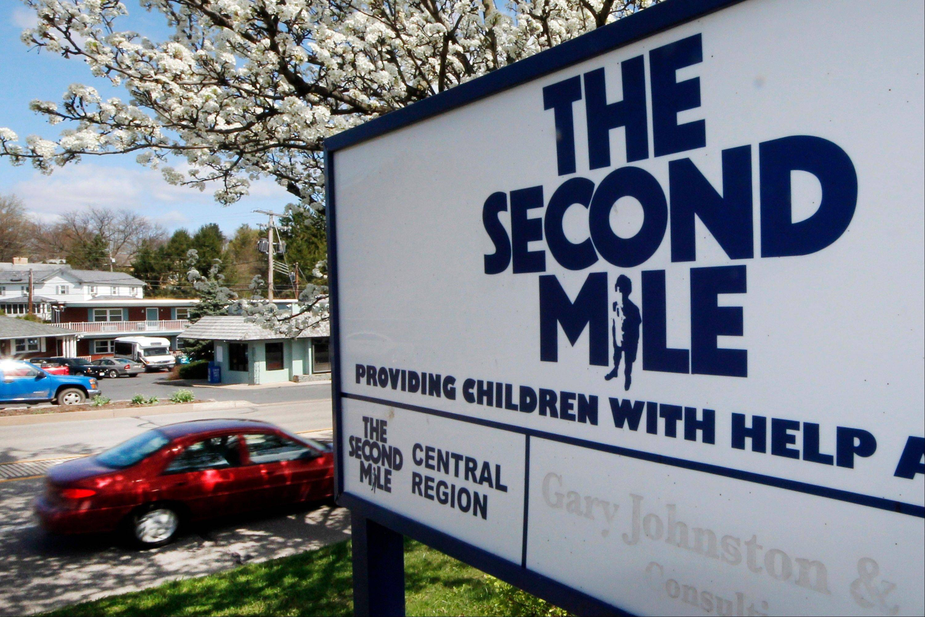 This March 26, 2012 file photo shows the sign outside the State College, Pa. office of The Second Mile. The charity for troubled youths started by Jerry Sandusky more than three decades ago.