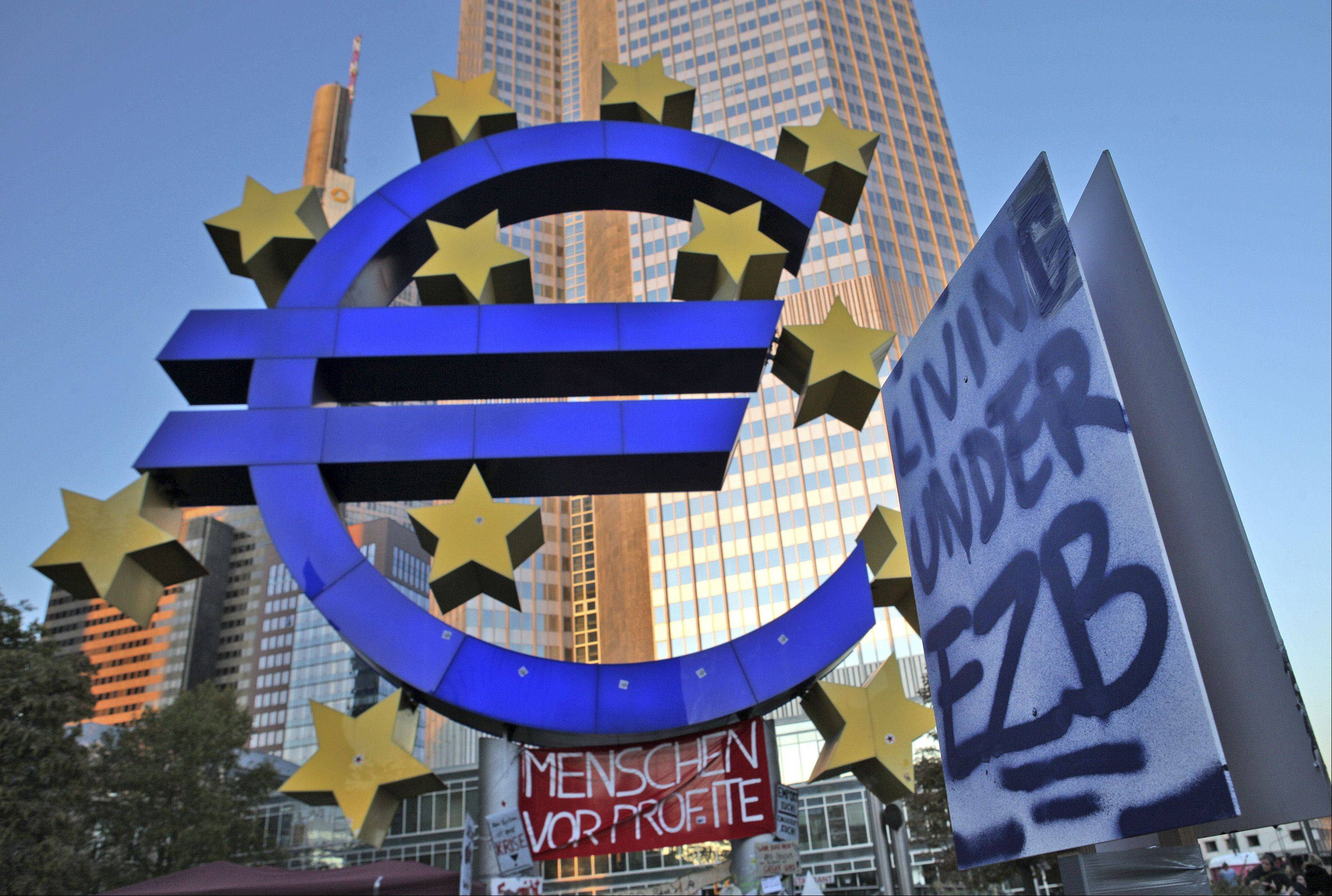 Banners are seen in front of the European Central Bank�s (ECB) headquarters during a demonstration in Frankfurt, Germany, on Sunday, Oct. 16, 2011.