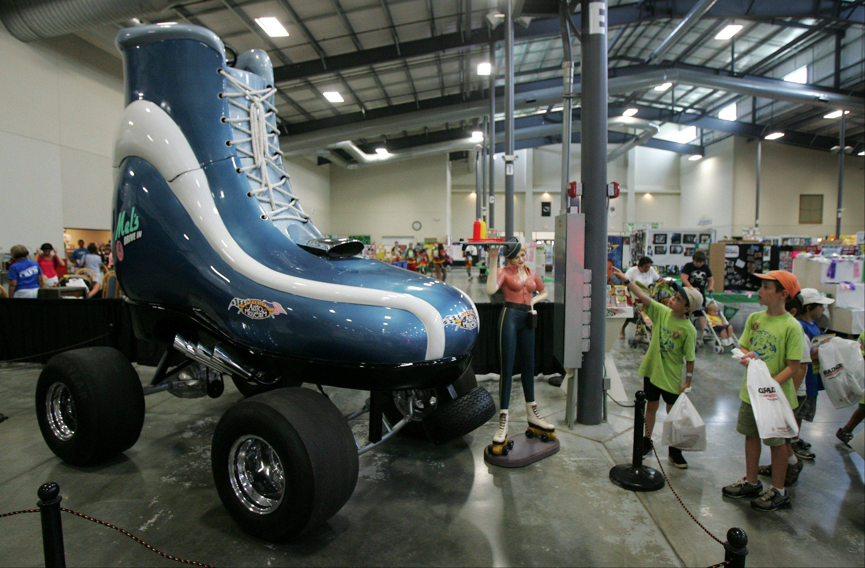 Children from Camp Gan Israel of Greater Chicago in Northbrook look at the giant Roller Skate car on display from the Volo Auto Museum during the first day of the Lake County Fair Wednesday in Grayslake.