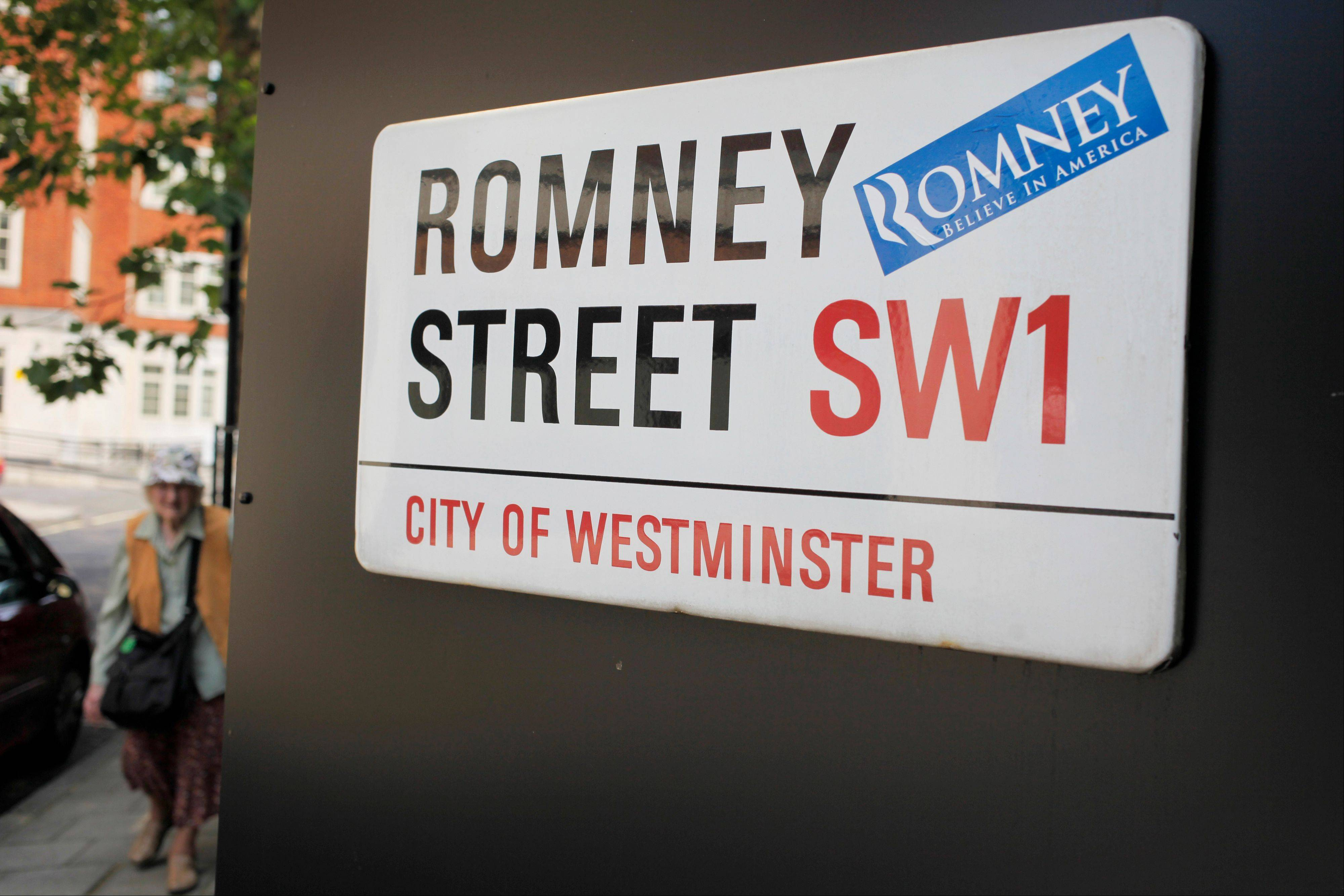 A campaign sticker for Republican presidential candidate, former Massachusetts Gov. Mitt Romney is seen on a street sign for Romney Street in London on Wednesday. The GOP candidate arrived in London to meet with world leaders, hold fundraisers and attend the opening of the Olympic games.