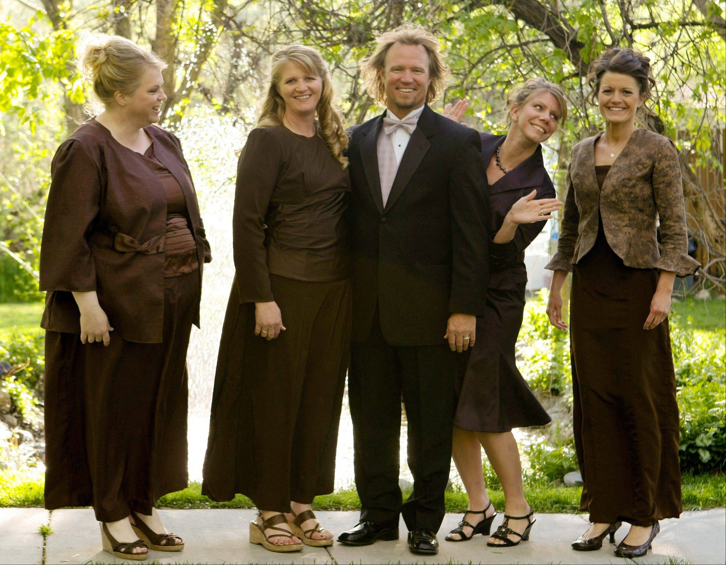 Kody Brown, center, poses with his wives, from left, Janelle, Christine, Meri and Robyn in a promotional photo for TLC�s reality TV show, �Sister Wives.� Utah has said it won�t prosecute consenting adult polygamists unless there are other crimes involved.