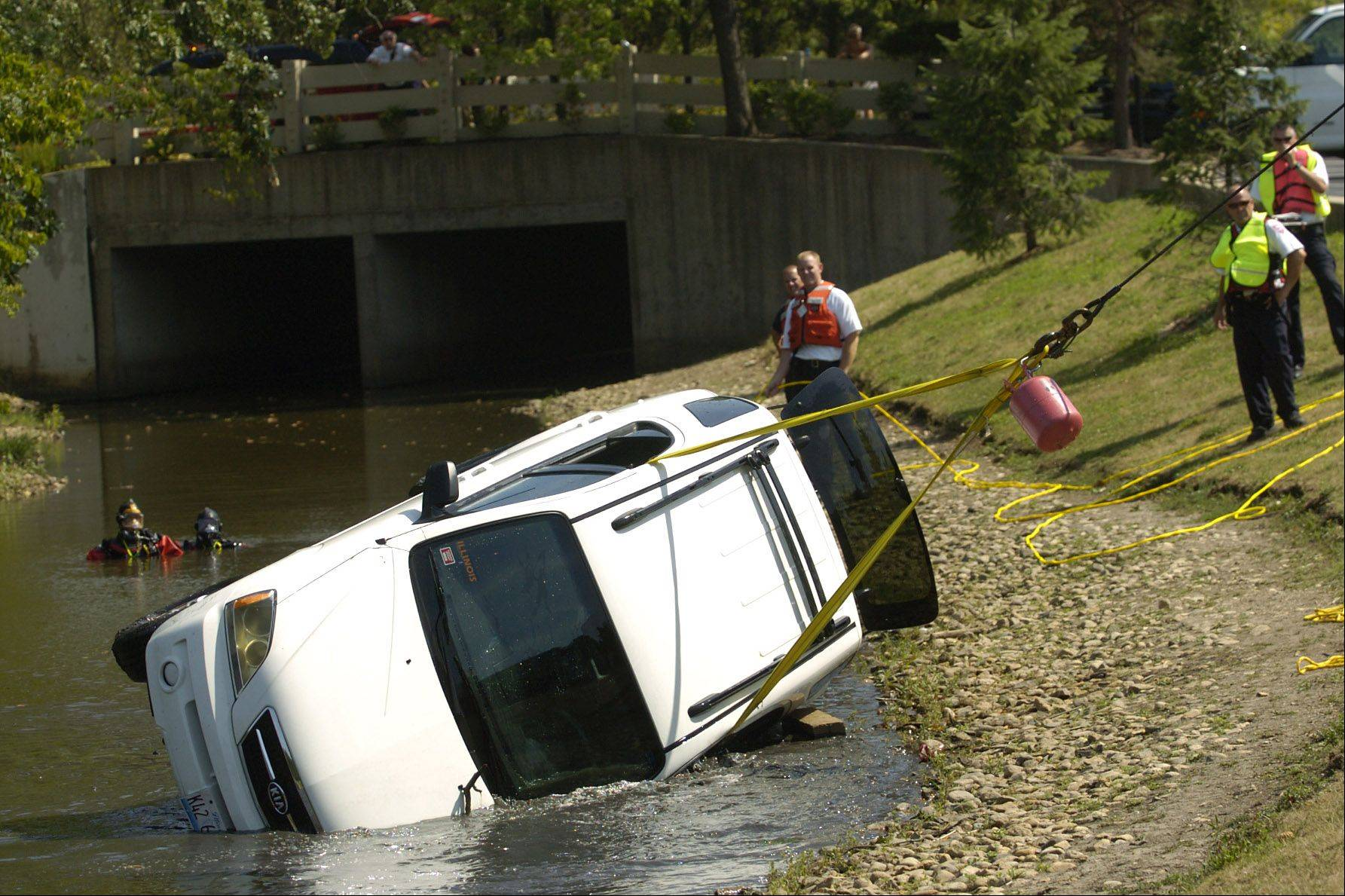 An SUV was pulled out of the pond in the Tree House Apartment complex in Schaumburg Wednesday afternoon after its driver accidentally plunged the vehicle into the water. The woman was able to get out of the vehicle unharmed.