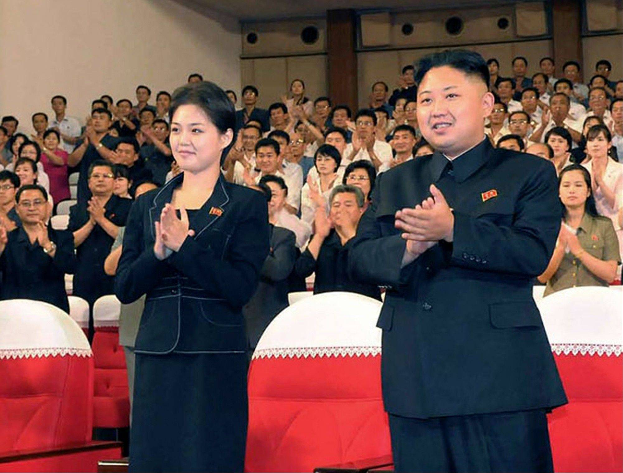 This file photo made available July 9, shows North Korean leader Kim Jong Un, right, and Ri Sol Ju as they applaud with others during a performance by North Korea�s new Moranbong band in Pyongyang, North Korea earlier in July