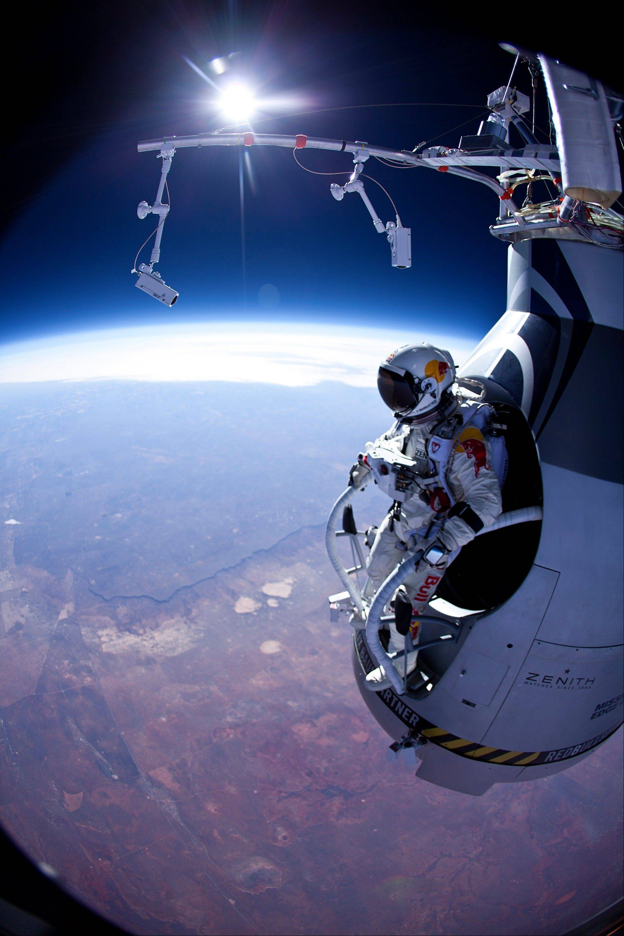 FILE - In this Thursday, March 15, 2012 photo provided by Red Bull Stratos, Felix Baumgartner prepares to jump during the first manned test flight for Red Bull Stratos over Roswell, N.M. On Wednesday, July 25, 2012, the 43-year-old Austrian plunged to Earth from an altitude of more than 18 miles landing safely near Roswell, N.M. It�s was second stratospheric leap for �Fearless Felix.� He�s aiming for a record-breaking jump from 125,000 feet, or 23 miles, in another month. He hopes to go supersonic, breaking the speed of sound with just his body.