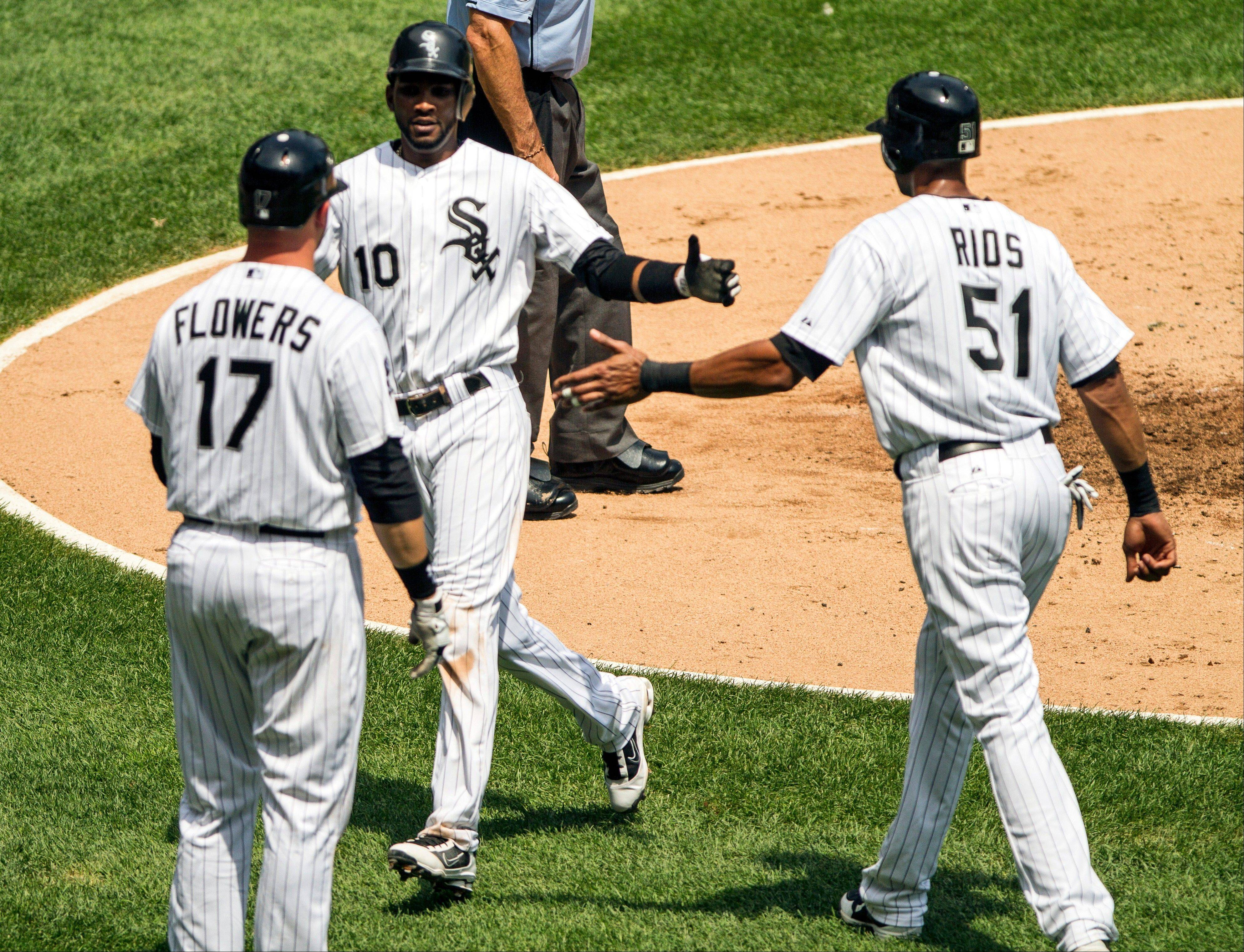 White Sox shortstop Alexei Ramirez (10) shakes hands with Tyler Flowers and Alex Rios Wednesday after scoring on Dayan Viciedo's hit in the second inning against the Minnesota Twins at U.S. Cellular Field.