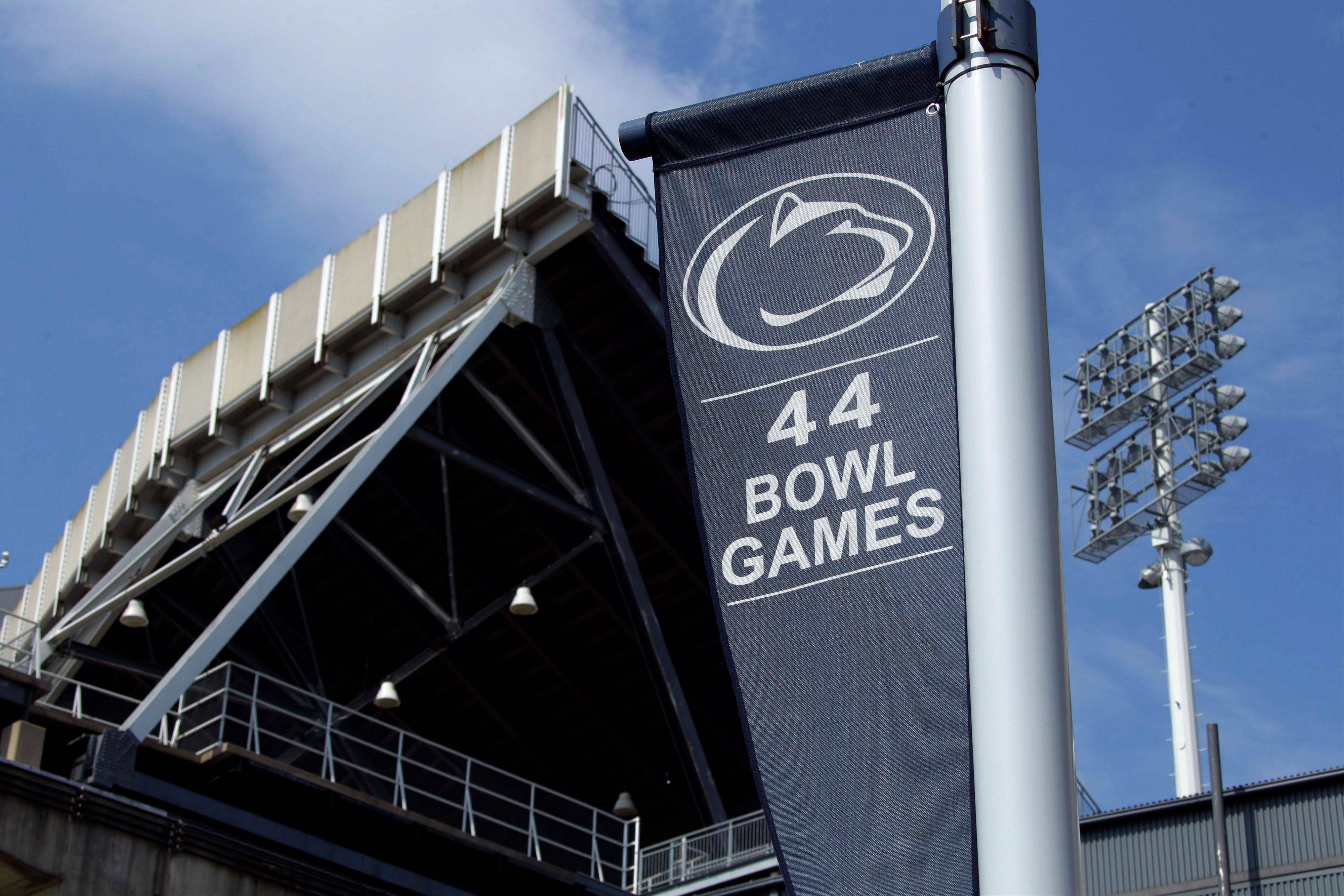 A banner celebrating the 44 bowl games that the Penn State football team has played in hangs outside of Beaver Stadium on the Penn State University main campus in State College, Pa., Monday, July 23, 2012. Penn State football was all but leveled Monday by an NCAA ruling that wiped away 14 years of coach Joe Paterno's victories and imposed a mountain of fines and penalties, crippling a program whose pedophile assistant coach spent uncounted years molesting children, sometimes on university property.