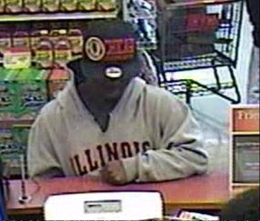 Courtesy of the FBISurveillance photos show a suspect robbing a TCF Bank branch inside a Bartlett Jewel-Osco on June 6. The suspect is wanted in connection to a Monday morning robbery of a Elmhurst bank.