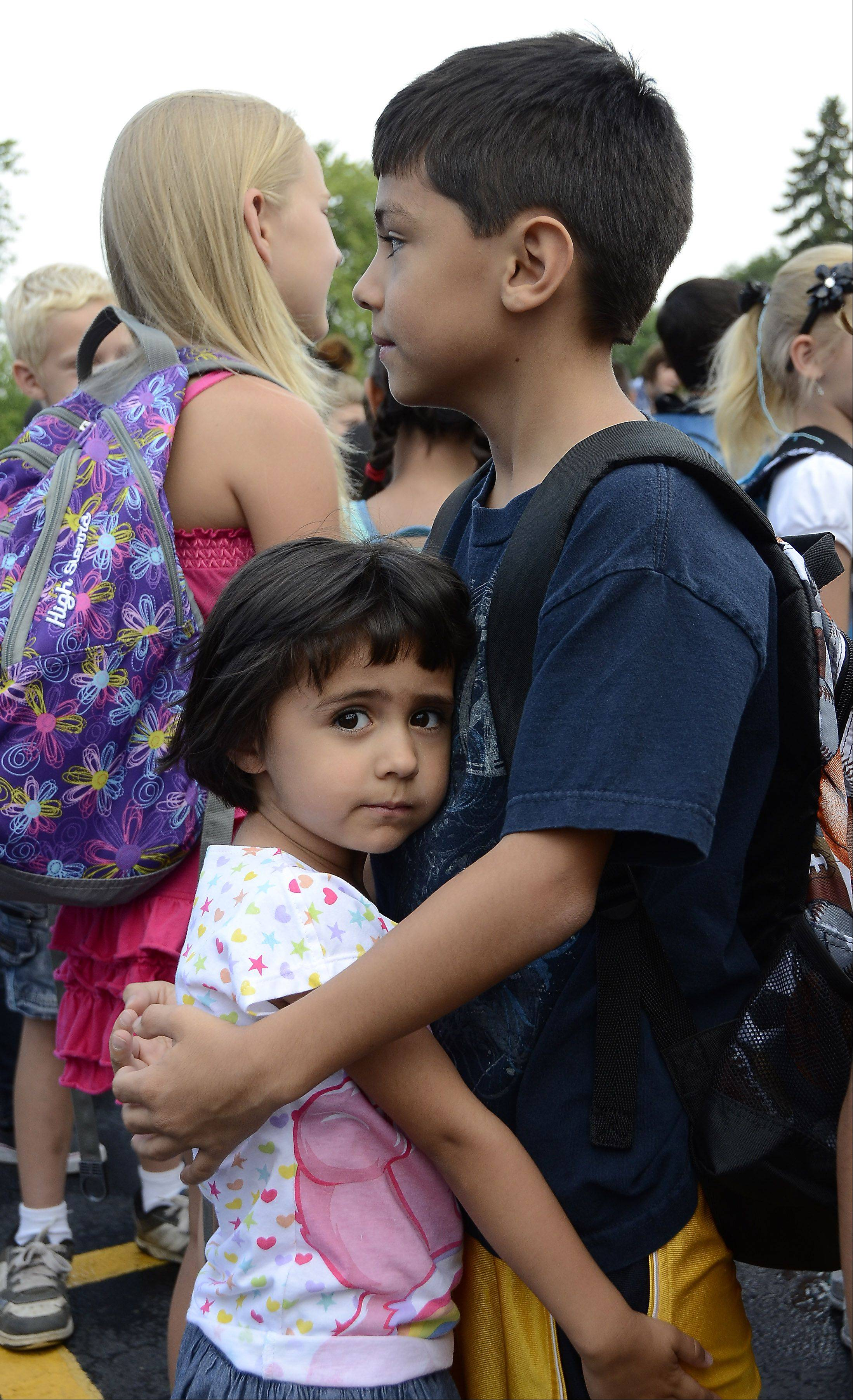 Coco Lomeli, 4, isn't quite ready for her brother, Christian, to leave her and go back to school. But Christian said he likes going to school year-round because he sees his friends all the time.